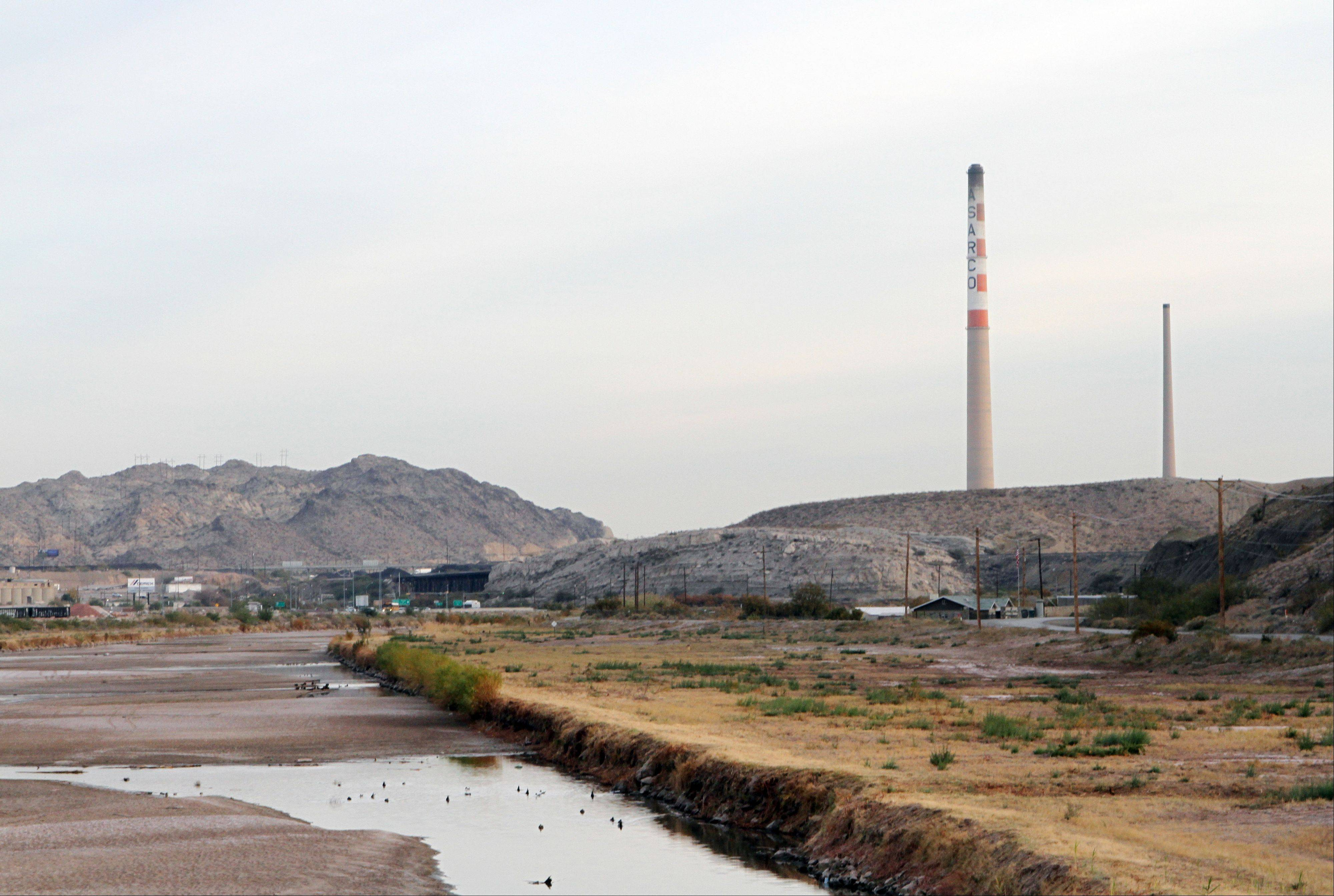 ASARCO copper smelter smokestacks near the Rio Grande in El Paso, Texas.