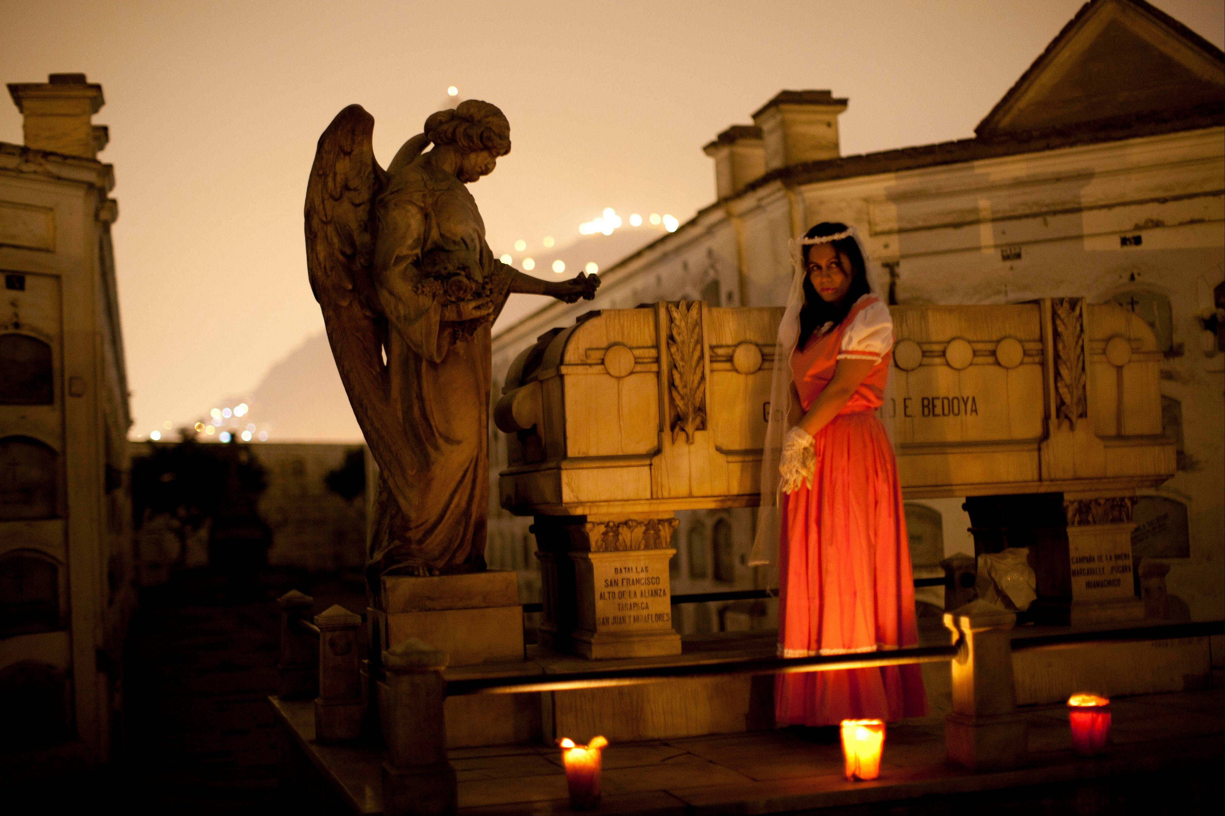 A performer dramatizes a historic event during a nighttime guided tour through the Presbitero Matias Maestro cemetery in Lima. The 54-acre cemetery is just 20 blocks from the presidential palace.