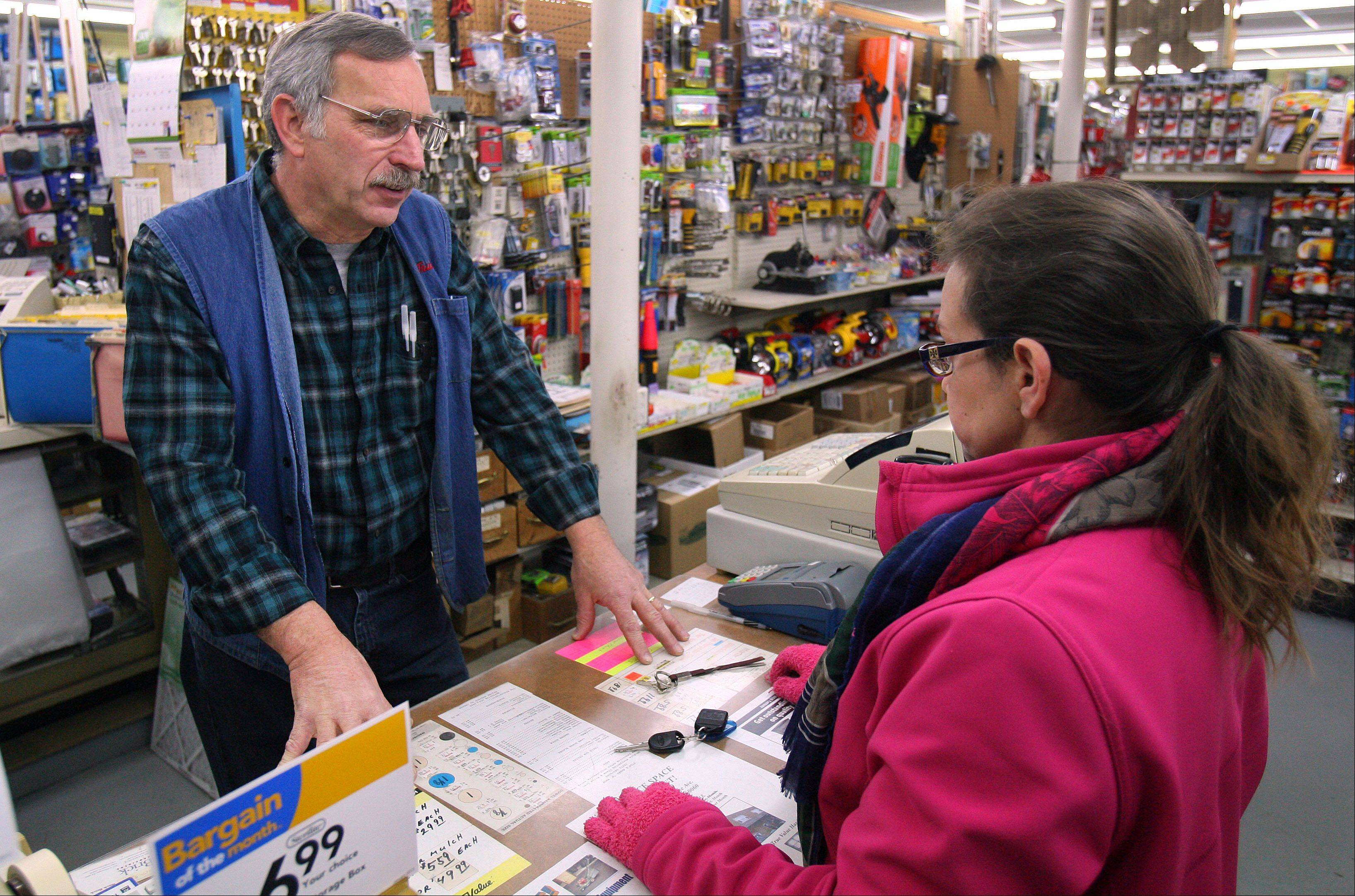 Ed LeJeune helps Tracy Lundman, of Libertyville, with a key purchase at the Libertyville True Value. The LeJeune family has operated the store on Milwaukee Avenue since 1967.