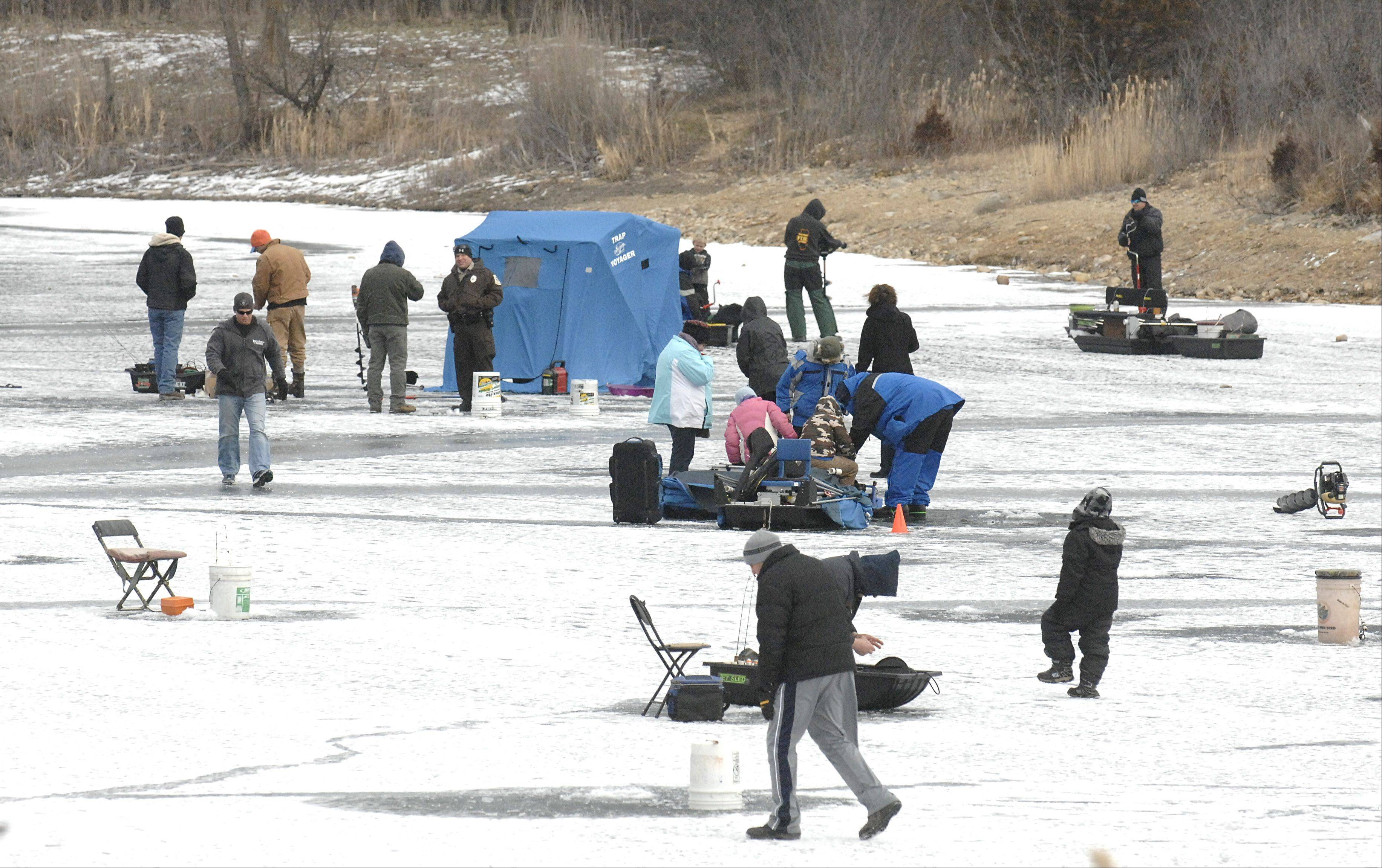 There were five inches of ice over Lake Atwood on Saturday for the McHenry Conservation District's Frost Fishing Fair in Cary.