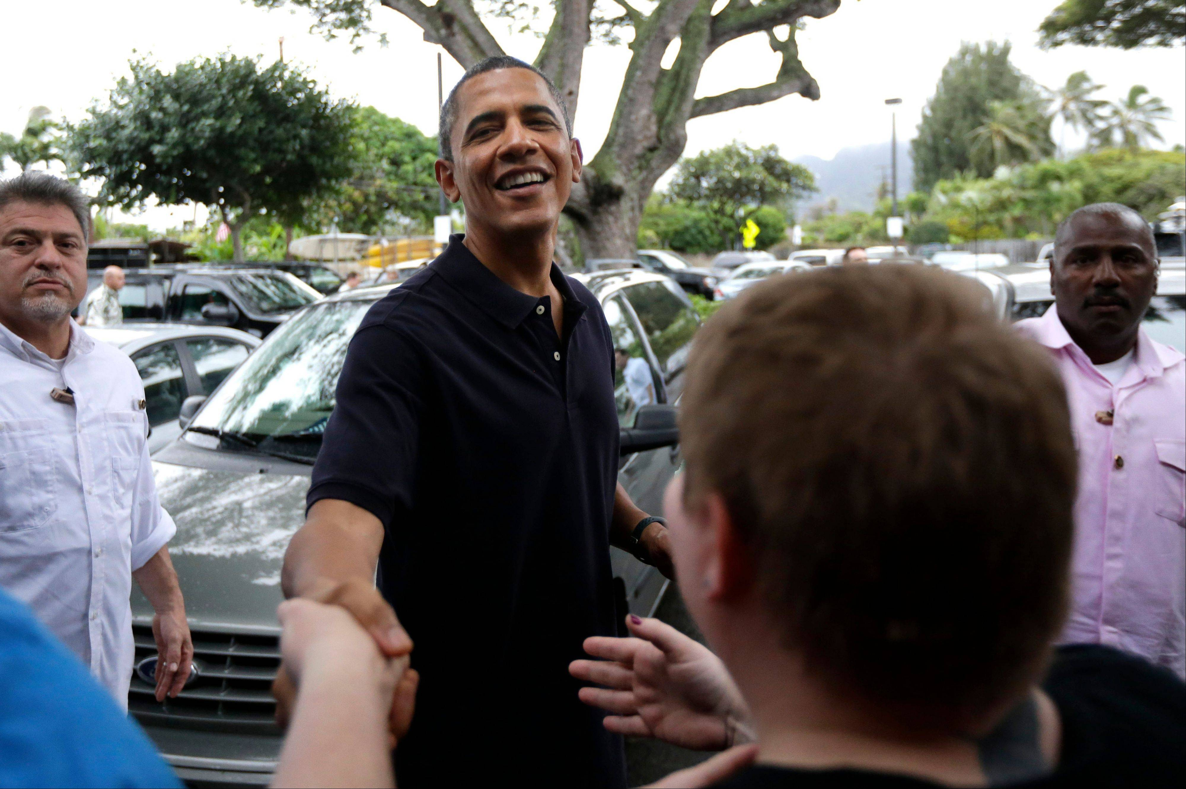 President Barack Obama greets people Thursday as he visits Island Snow for shave ice in Kailua, Hawaii, during his holiday vacation.