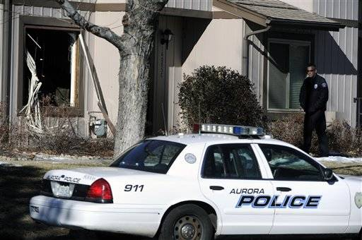 A gunman barricaded inside his Colorado home fired shots at police from a second-story window before he was killed as SWAT officers stormed the home Saturday. Once inside, they found the bodies of three other adults, authorities said.
