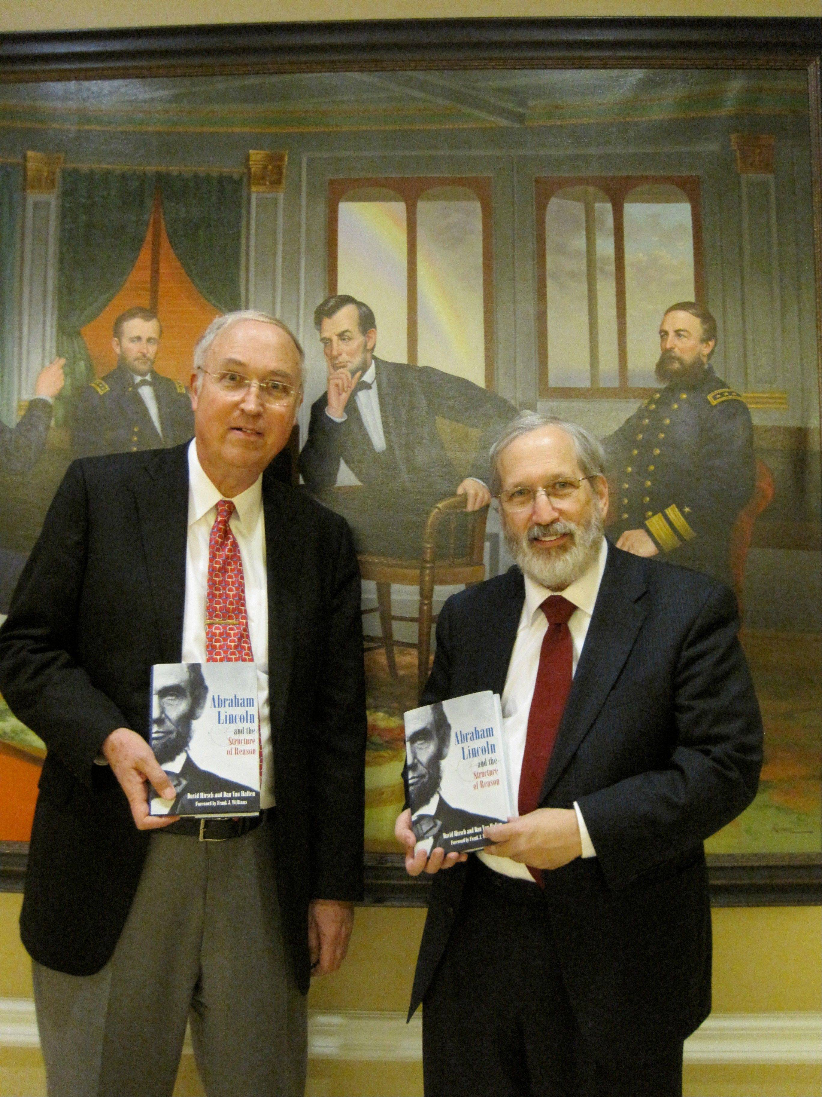 Authors Dan Van Haften, left, and David Hirsch pose with the book they wrote after studying the speeches of Abraham Lincoln. Van Haften recently discussed the book in Washington, D.C.
