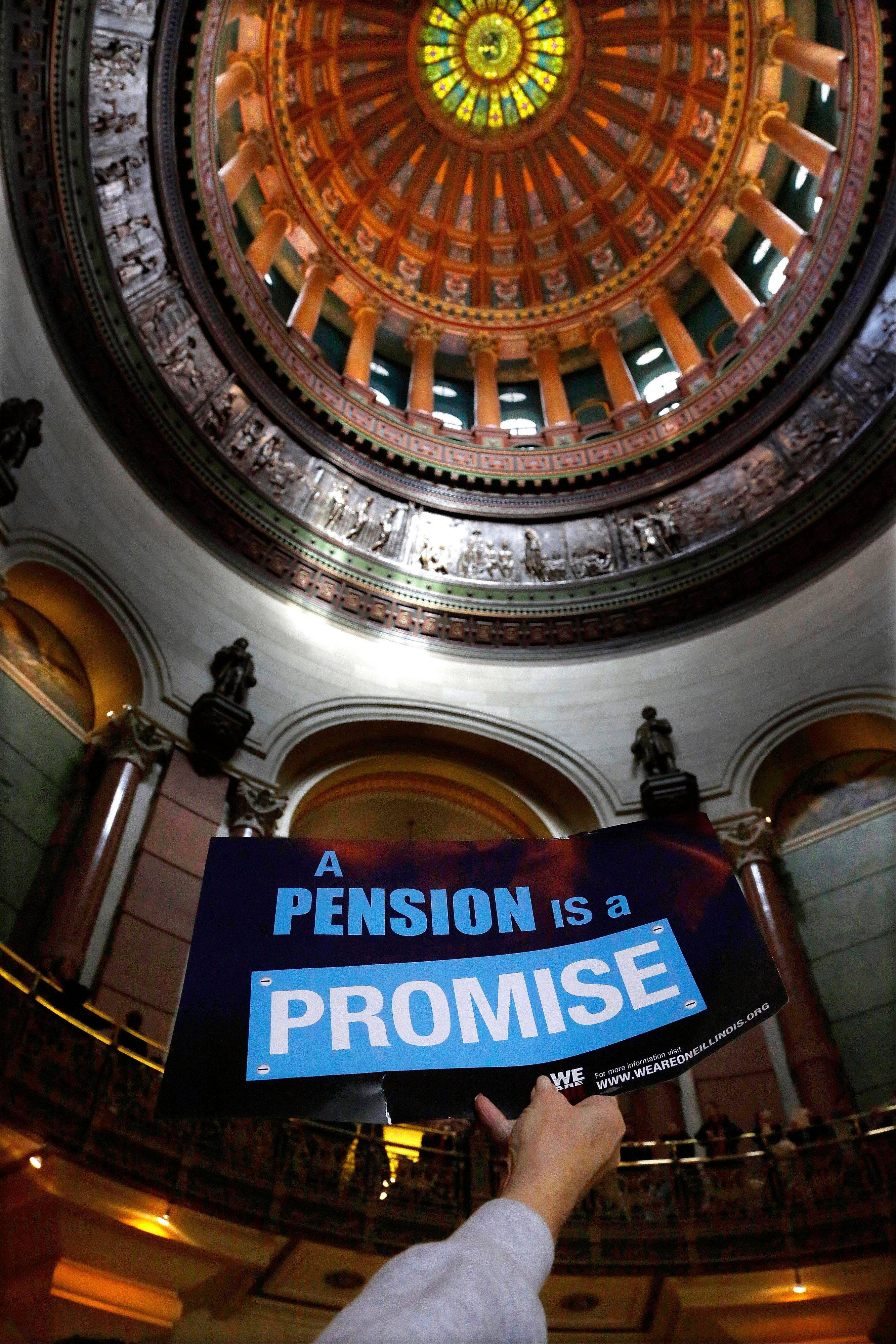 "A ""Pension Promise"" sign is seen as Illinois state union members and supporters rally in support for fair pension reform in the rotundra at the Illinois State Capitol Thursday, Jan. 3, 2013 in Springfield Ill."