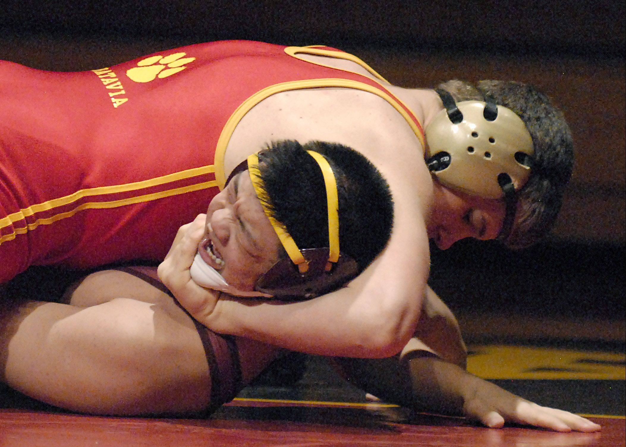 Batavia's Nick Whittman won his 170-pound match against Schaumburg's Woo Lee on Saturday in Batavia.
