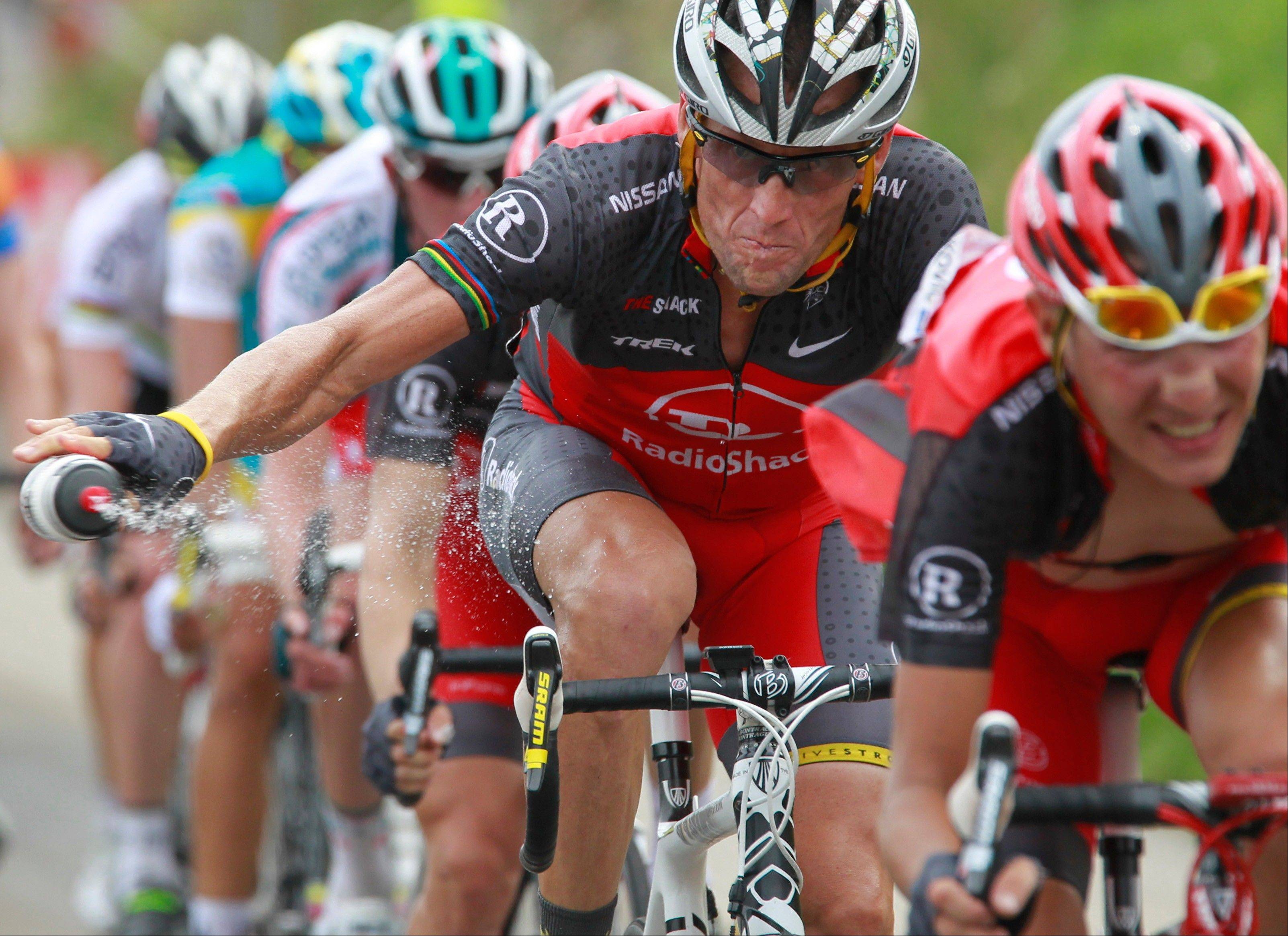 FILE - In this July 10, 2010, file photo, Lance Armstrong throws out his water bottle in the last kilometers of the climb toward Station les Rousses, France, during the seventh stage of the Tour de France cycling race. The New York Times reported Friday, Jan. 4, 2013, that Armstrong, who has strongly denied the doping charges that led to him being stripped of his seven Tour de France titles, has told associates he is considering admitting to the use of performance-enhancing drugs. Armstrong attorney Tim Herman denied that Armstrong has reached out to USADA chief executive Travis Tygart and David Howman, director general of the World Anti-Doping Agency.