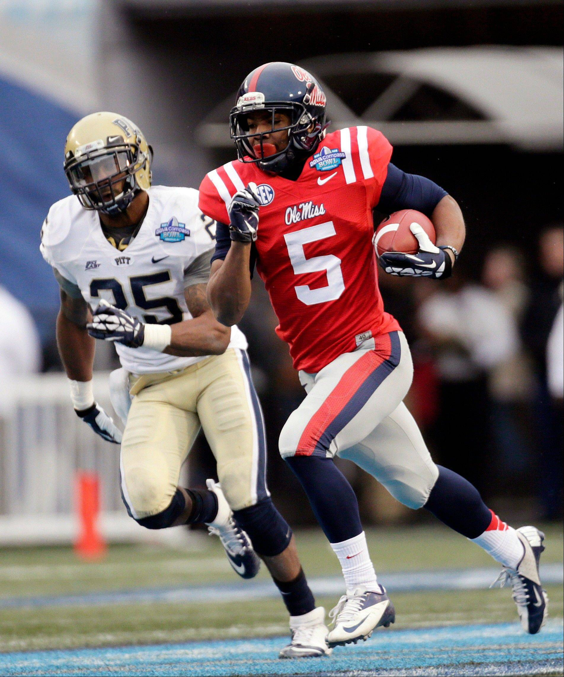 Mississippi running back I'Tavius Mathers (5) rushes for a 62-yard touchdown as Pittsburgh defensive back Jason Hendricks (25) trails in the second half of the BBVA Compass Bowl NCAA college football game at Legion Field in Birmingham, Ala., Saturday, Jan. 5, 2013. Mississippi won 38-17.