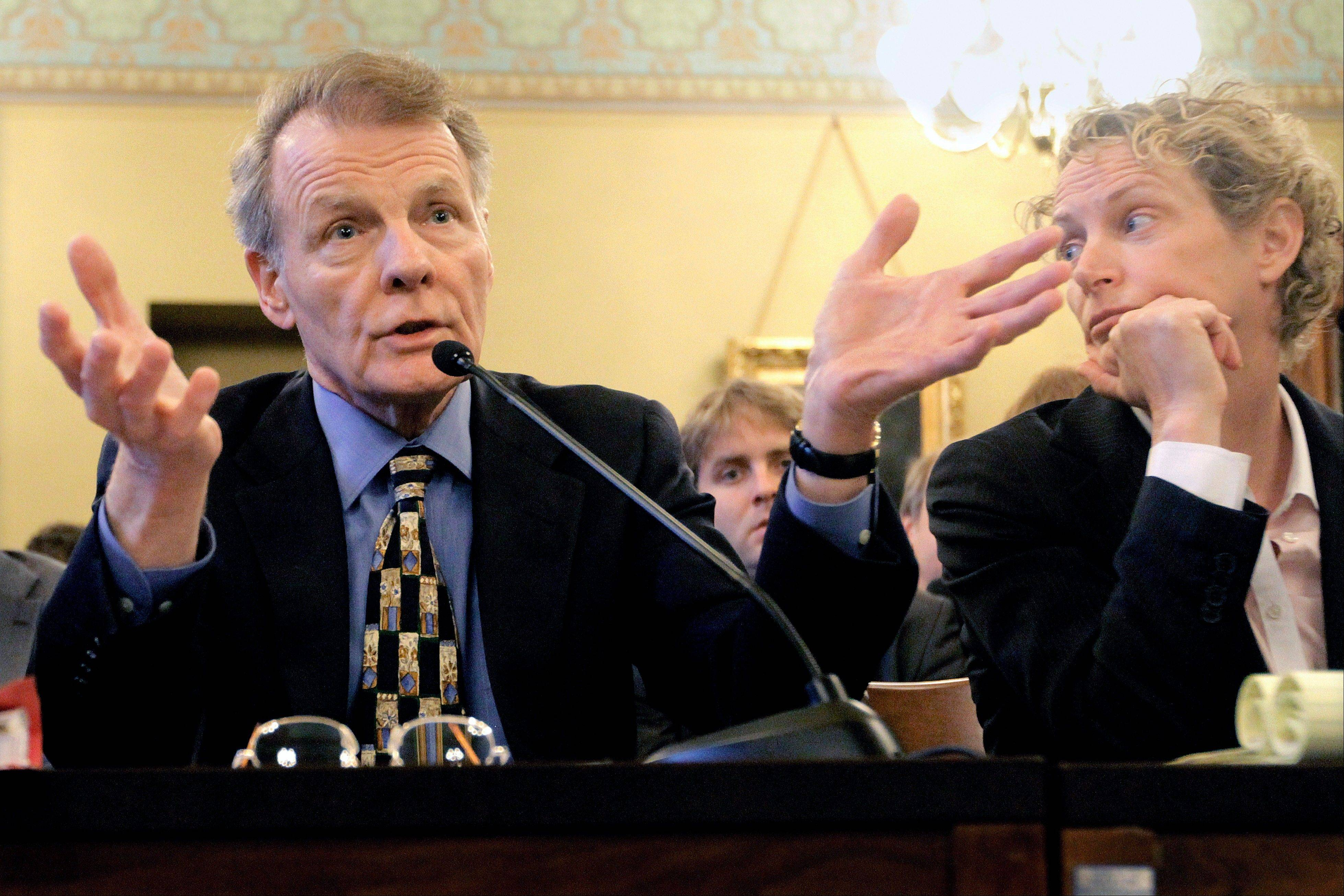 Illinois House Speaker Michael Madigan, left, testifies while Rep. Elaine Nekritz, of Northbrook, looks on during a hearing in May.