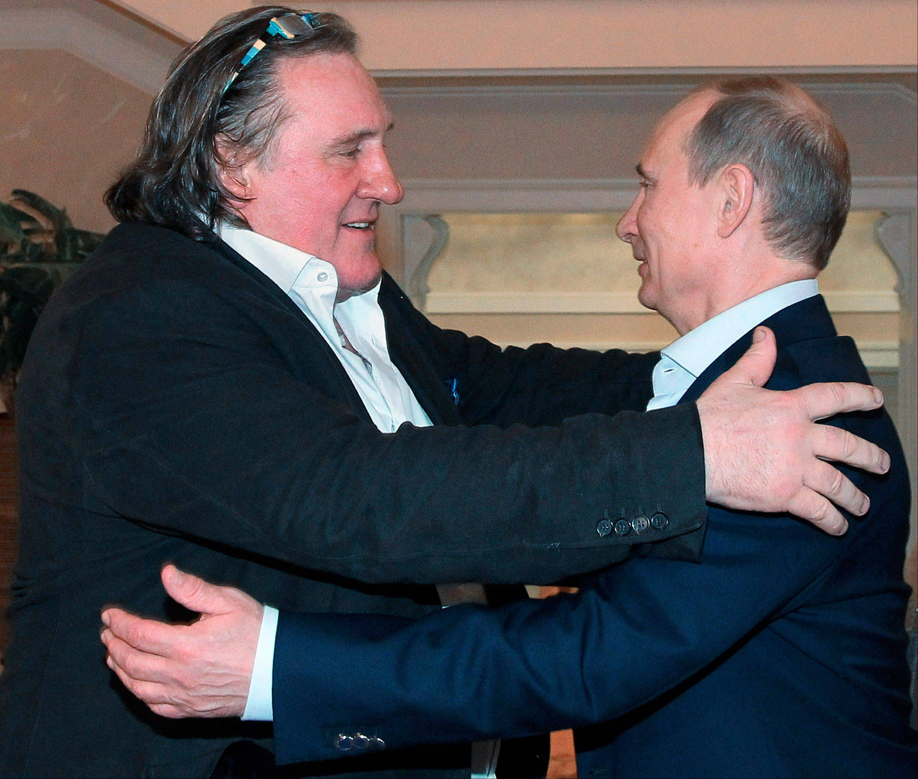 French actor Gerard Depardieu, left, greets Russian President Vladimir Putin after his arrival late Saturday at the president's residence in Sochi, the host city of the 2014 Winter Olympics.