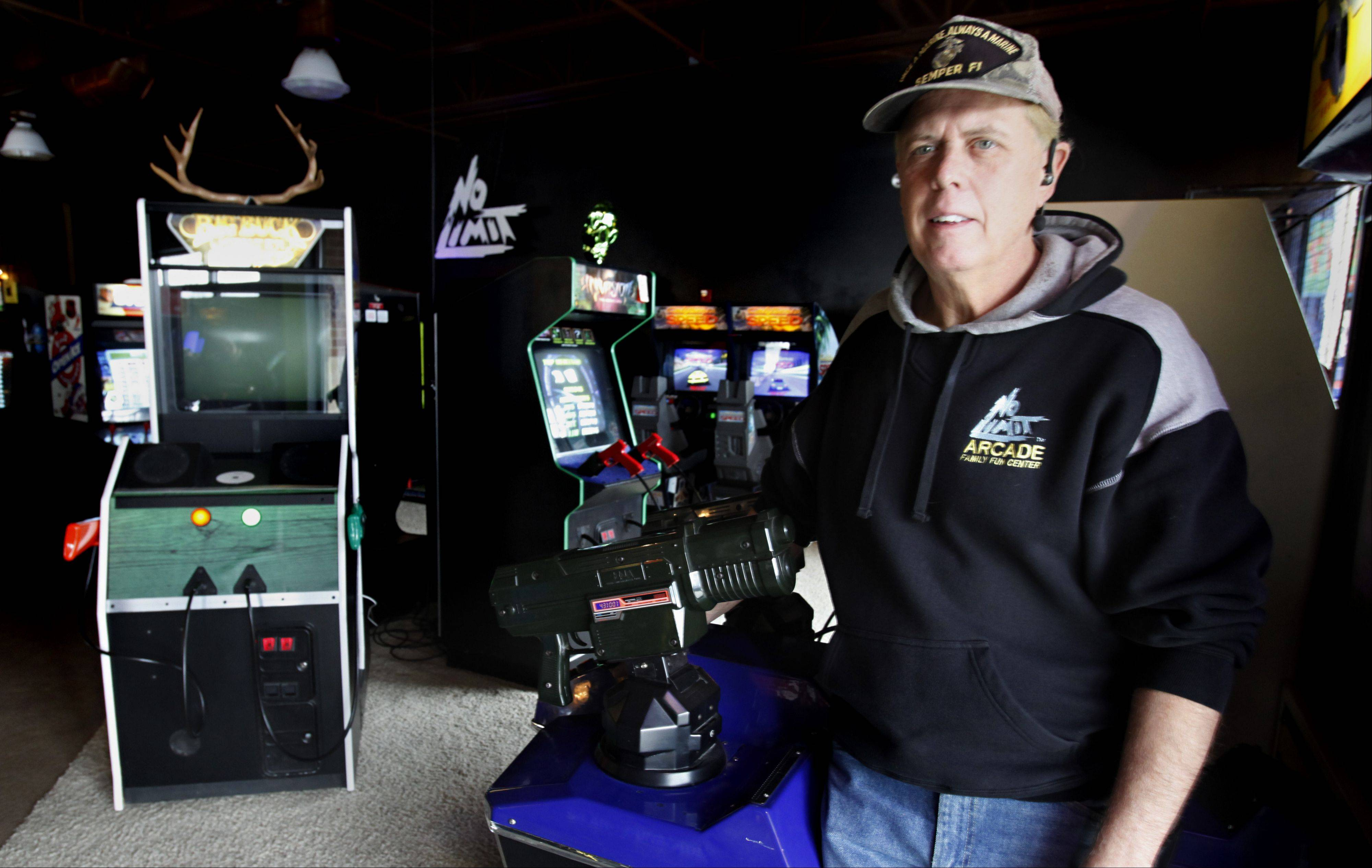 "Algonquin video arcade owner Kevin Slota will replace 12 games he says are excessively violent. His action was prompted by the Connecticut school shootings. He's OK with such games as ""Big Buck Hunter,"" at left, because the targets aren't people."