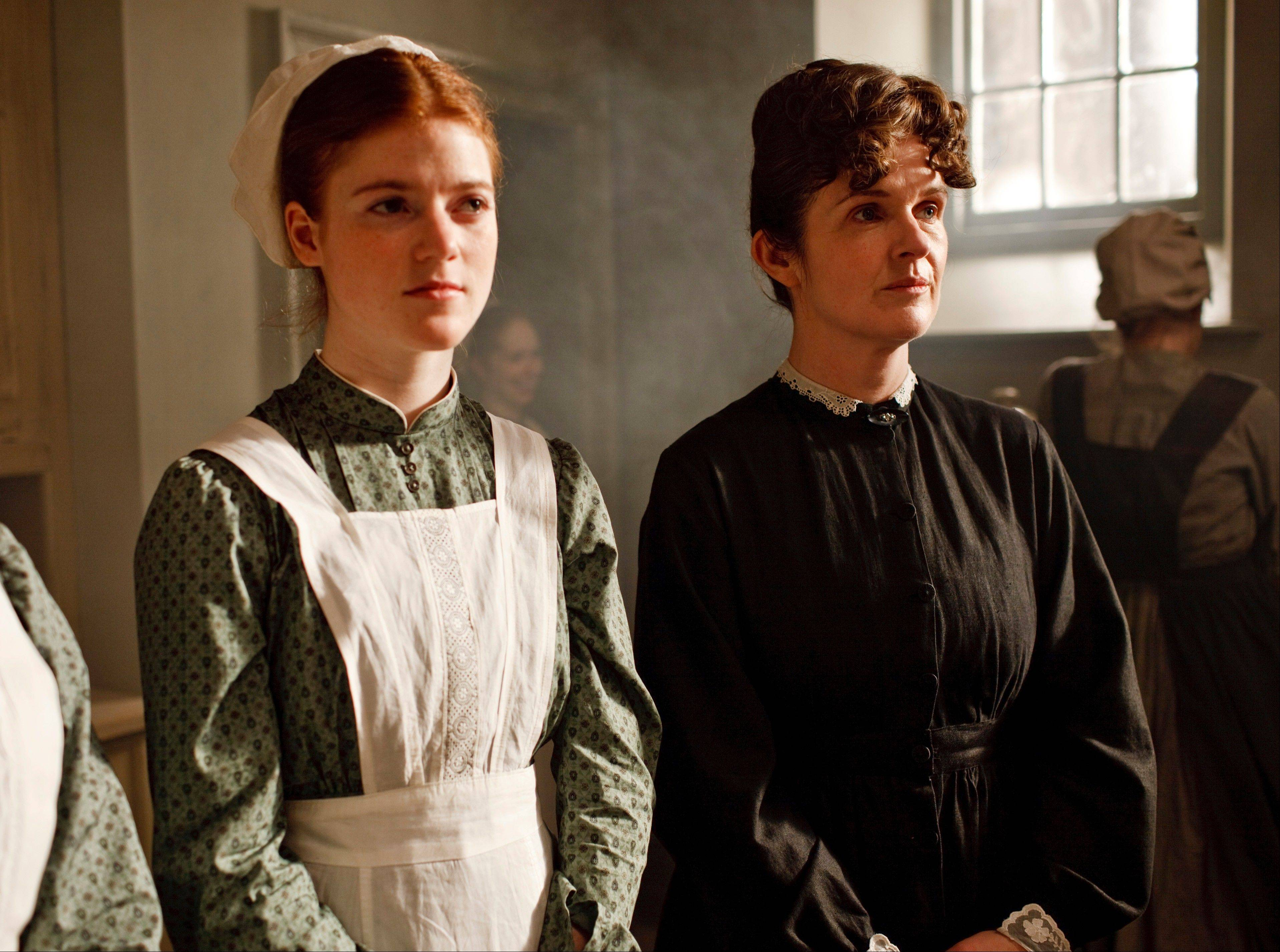 "Rose Leslie, left, and Siobhan Finneran are shown in a scene from ""Downton Abbey."" Food plays a role in the series. Rather than letting it serve as mere eye candy, creator and writer Julian Fellowes has worked crepes, puddings, roast chicken and other edible props into some of the series' most memorable plots."