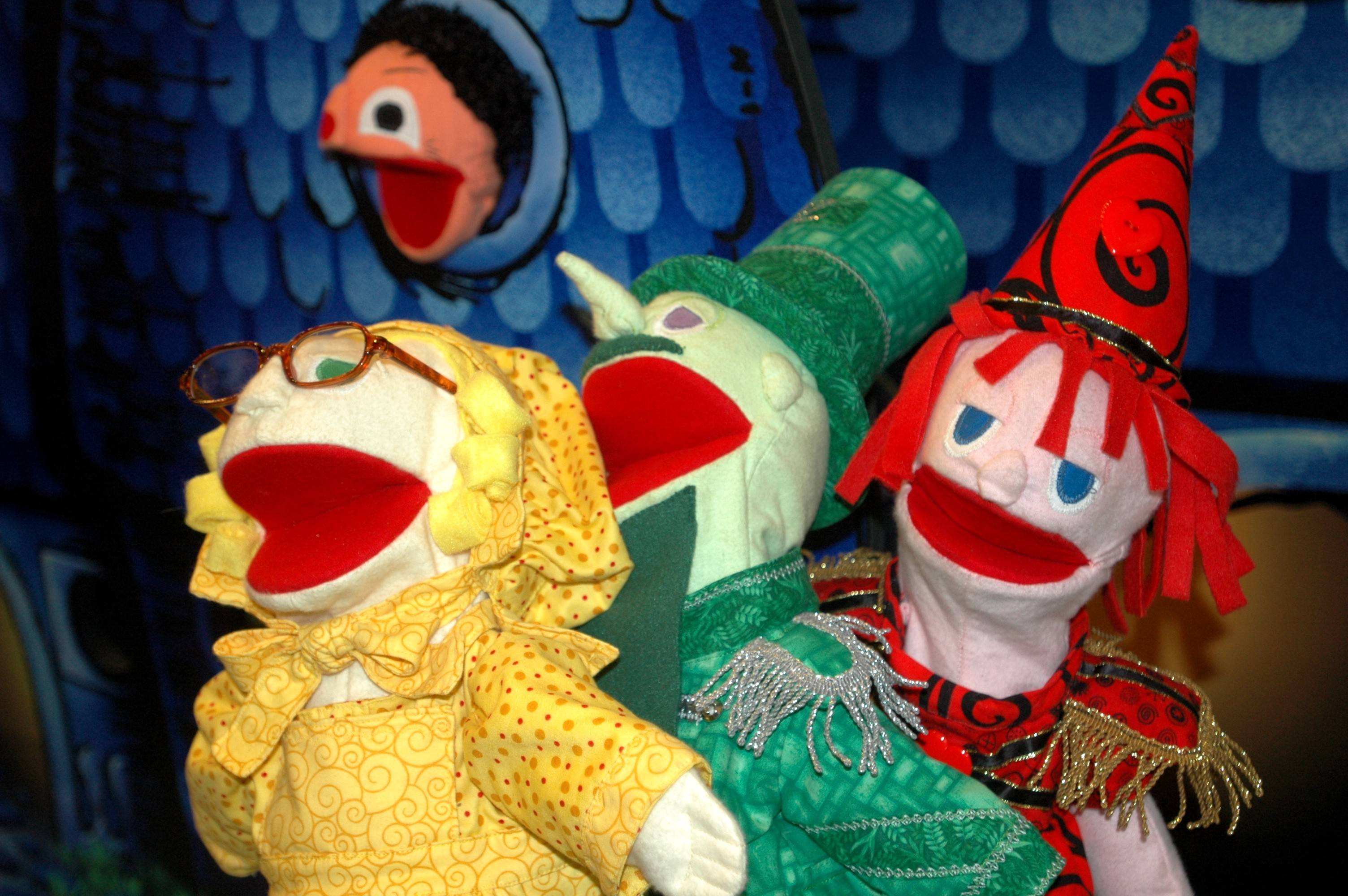 Colorful puppets are part of