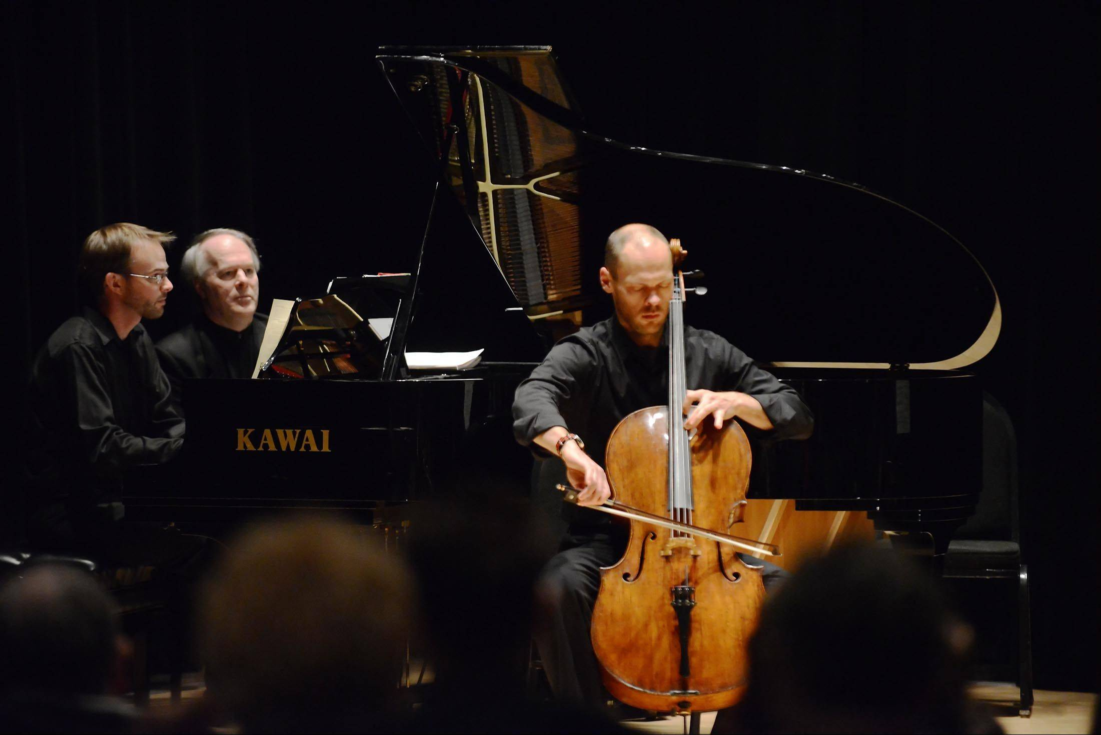 Brant Taylor, of the Chicago Symphony Orchestra, plays the cello Sunday during the Elgin Youth Symphony Orchestra faculty's fundraising recital at Elgin Community College. David Anderson accompanies him on piano. Taylor is the coach of the EYSO's Maud Powell String Quartet.