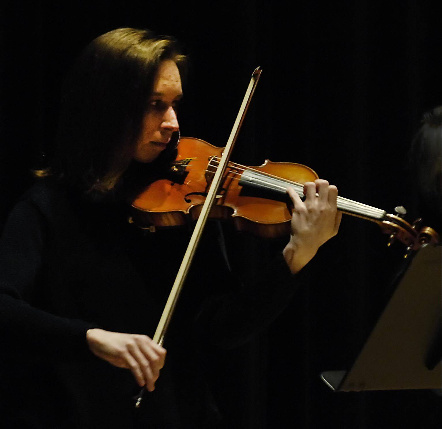 Beth Wood plays the violin Sunday during the Elgin Youth Symphony Orchestra faculty's fundraising recital at Elgin Community College. Wood is the conductor of the Primo Orchestra and was a member of the EYSO when she was a student.