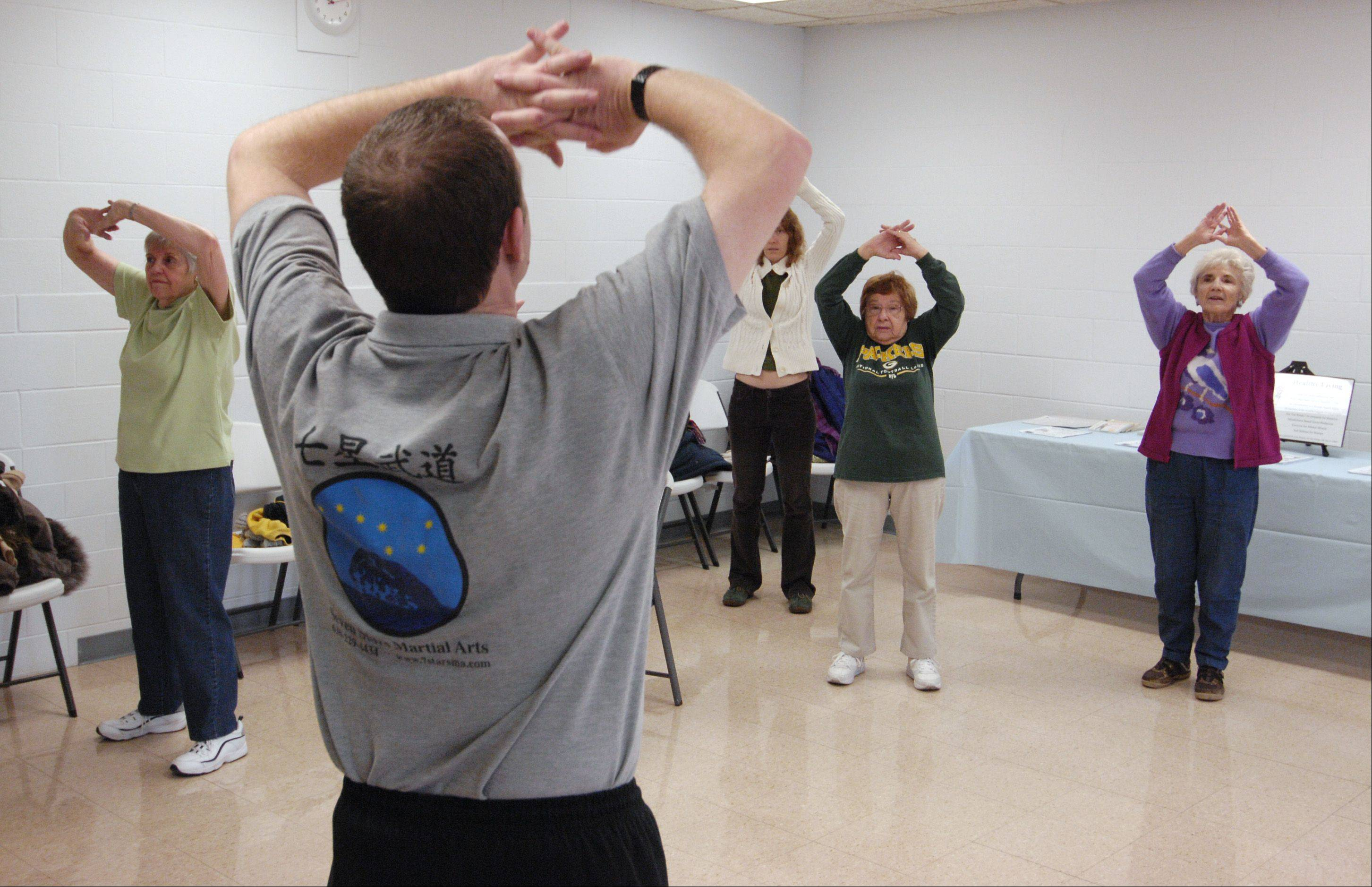 John Robertson demonstrates Tai Chi during the Lombard Park District's Health Fair and Fitness Expo Sunday at the Sunset Knoll Recreation Center.