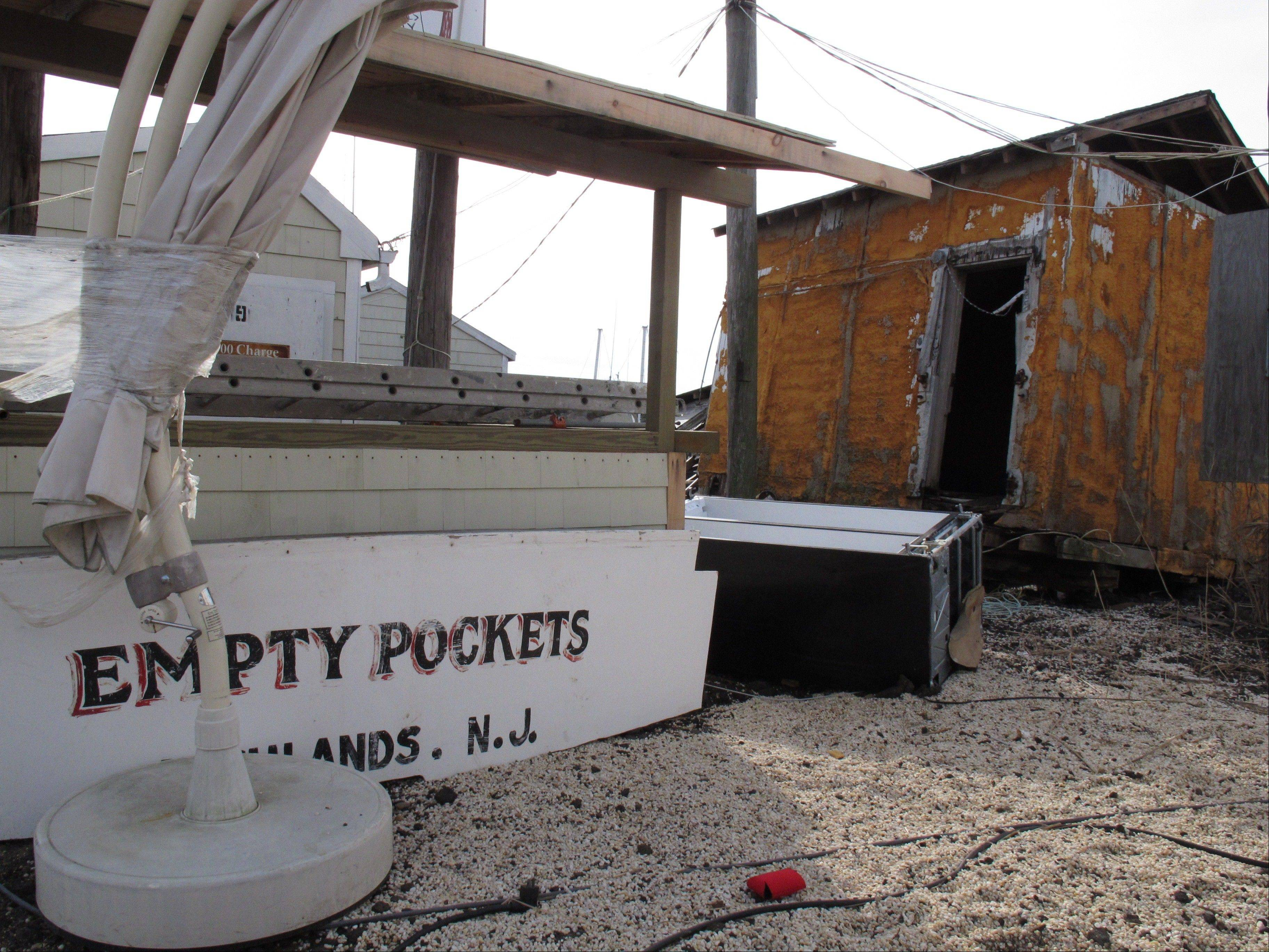 "A fishing boat named ""Empty Pockets"" seems oddly prophetic as it sits in a parking lot in the Belford fishing port in Middletown, N.J."