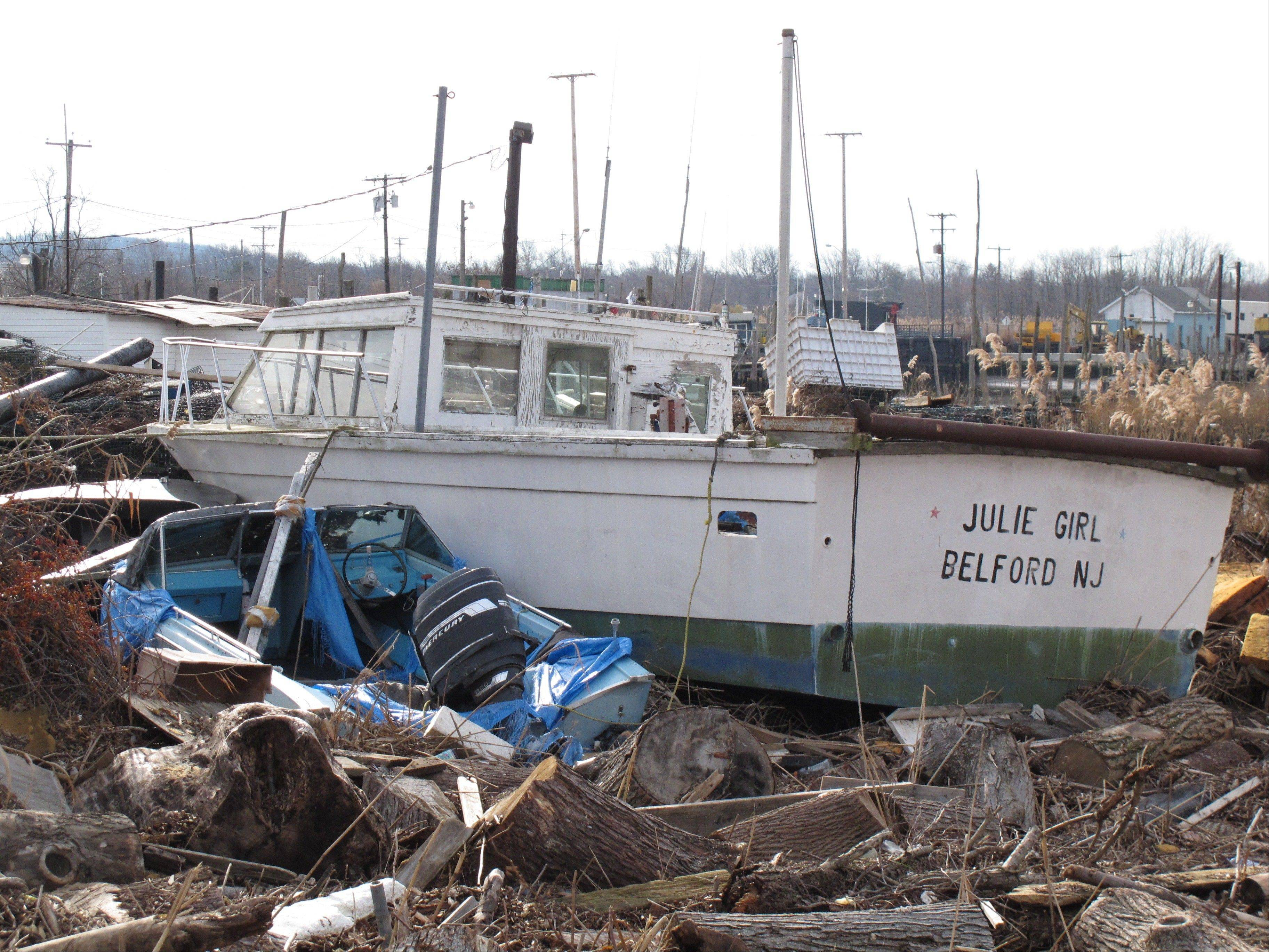 Fishing boats lie smashed against one another from Superstorm Sandy at the Belford fishing port in Middletown N.J.
