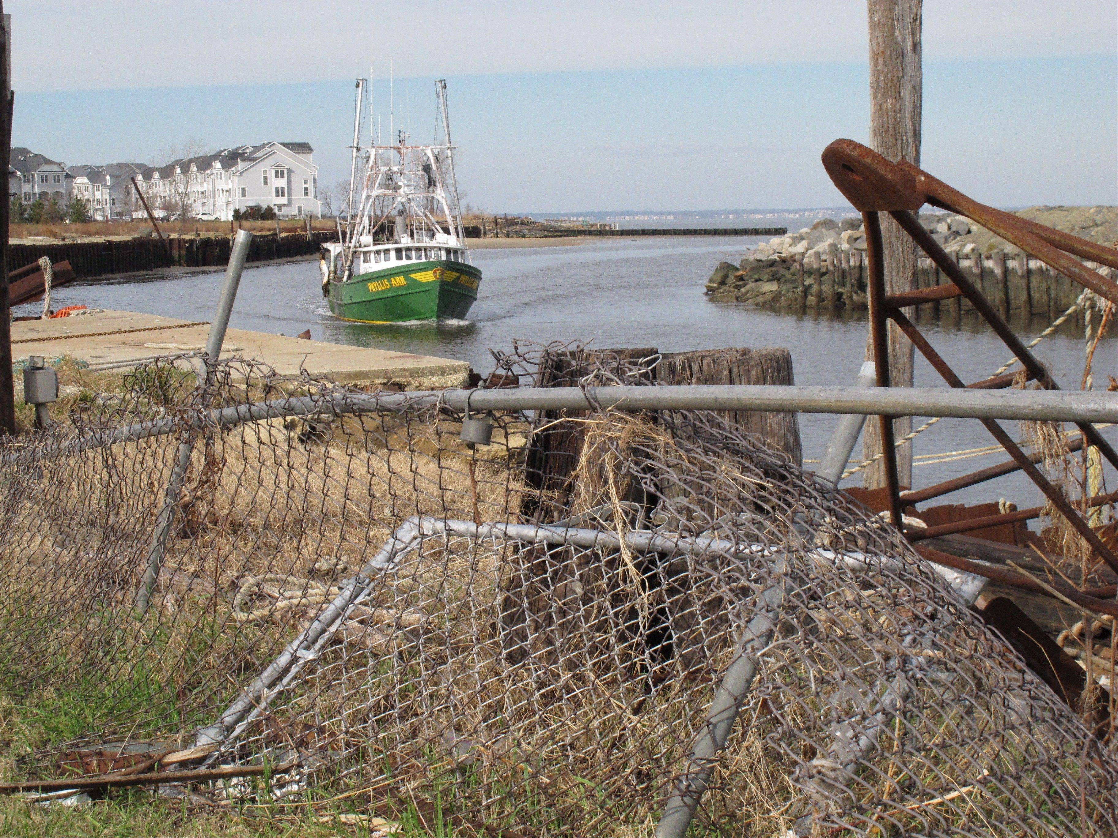 A fishing boat returns to the damaged Belford port in Middletown N.J. The port sustained nearly $1 million in damages from Superstorm Sandy, some of which its owners hope to recoup through federal storm aid.