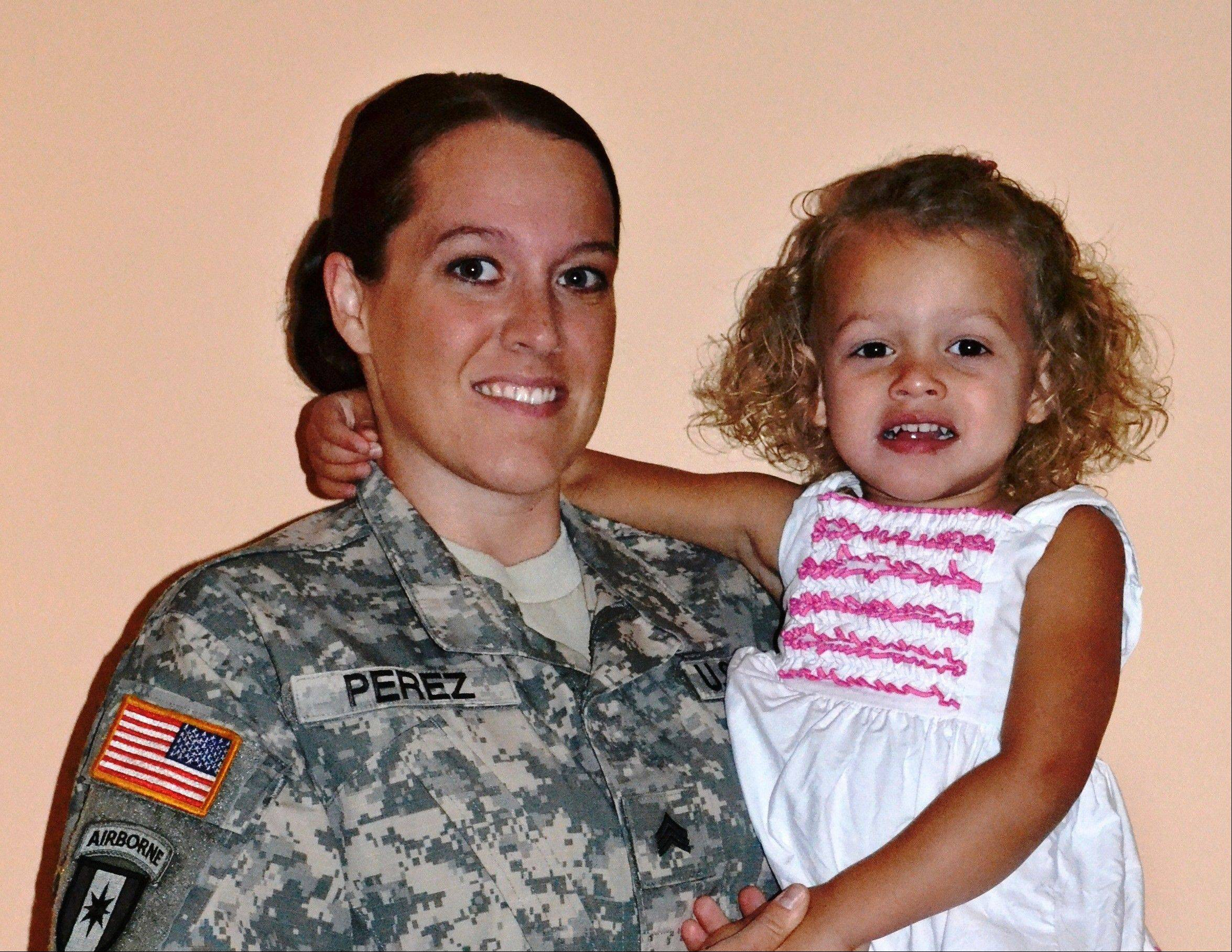 In choosing to serve her country in uniform, Hayleigh Lynn Perez, shown here with daughter Calleigh, knowingly accepted a nomadic life. Now the former Army sergeant says she and thousands of other veterans trying to get a higher education are being penalized for that enforced rootlessness.