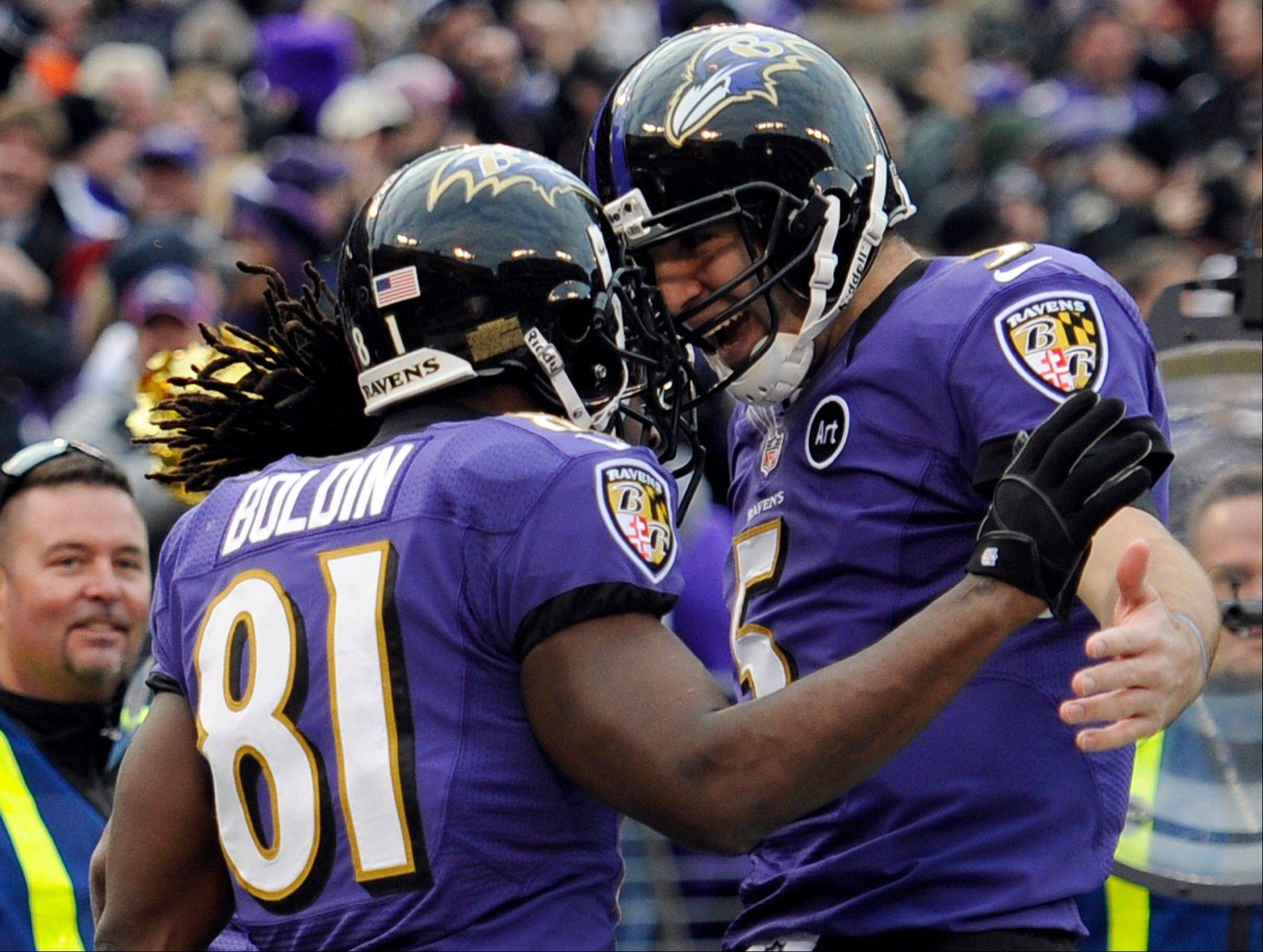 Baltimore Ravens wide receiver Anquan Boldin (81) celebrates his touchdown catch with quarterback Joe Flacco (5) during the second half of an NFL wild card playoff football game against the Indianapolis Colts Sunday, Jan. 6, 2013, in Baltimore.