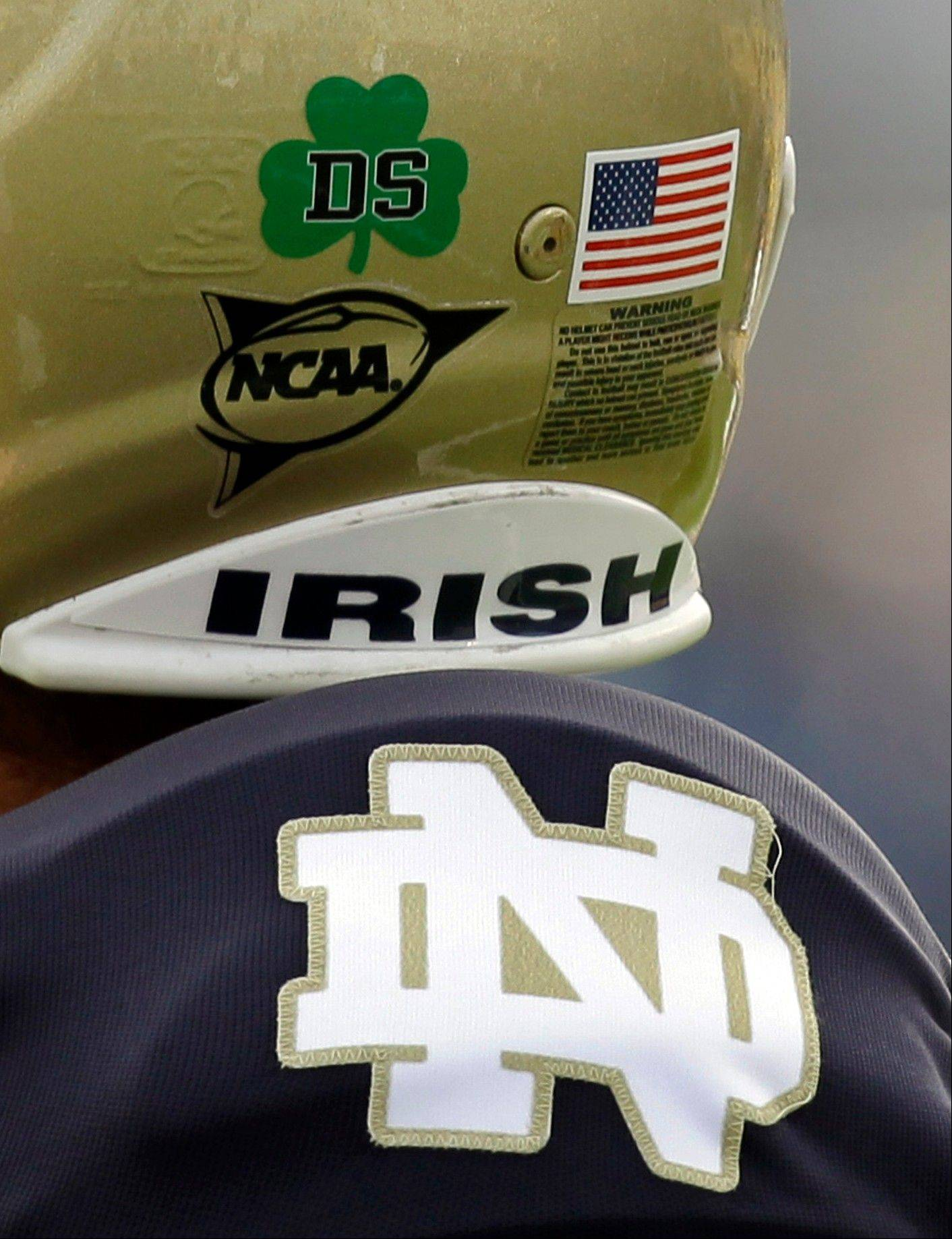 "In this Oct. 30, 2010, file photo, Notre Dame kicker Brandon Walker wears a ""DS"" sticker honoring Declan Sullivan before the start of a game against Tulsa in South Bend, Ind. Sullivan would have been in his element this weekend, video camera at hand, adding his own sly observations about the team for which he grew up rooting and served as a film assistant until his death in October 2010."
