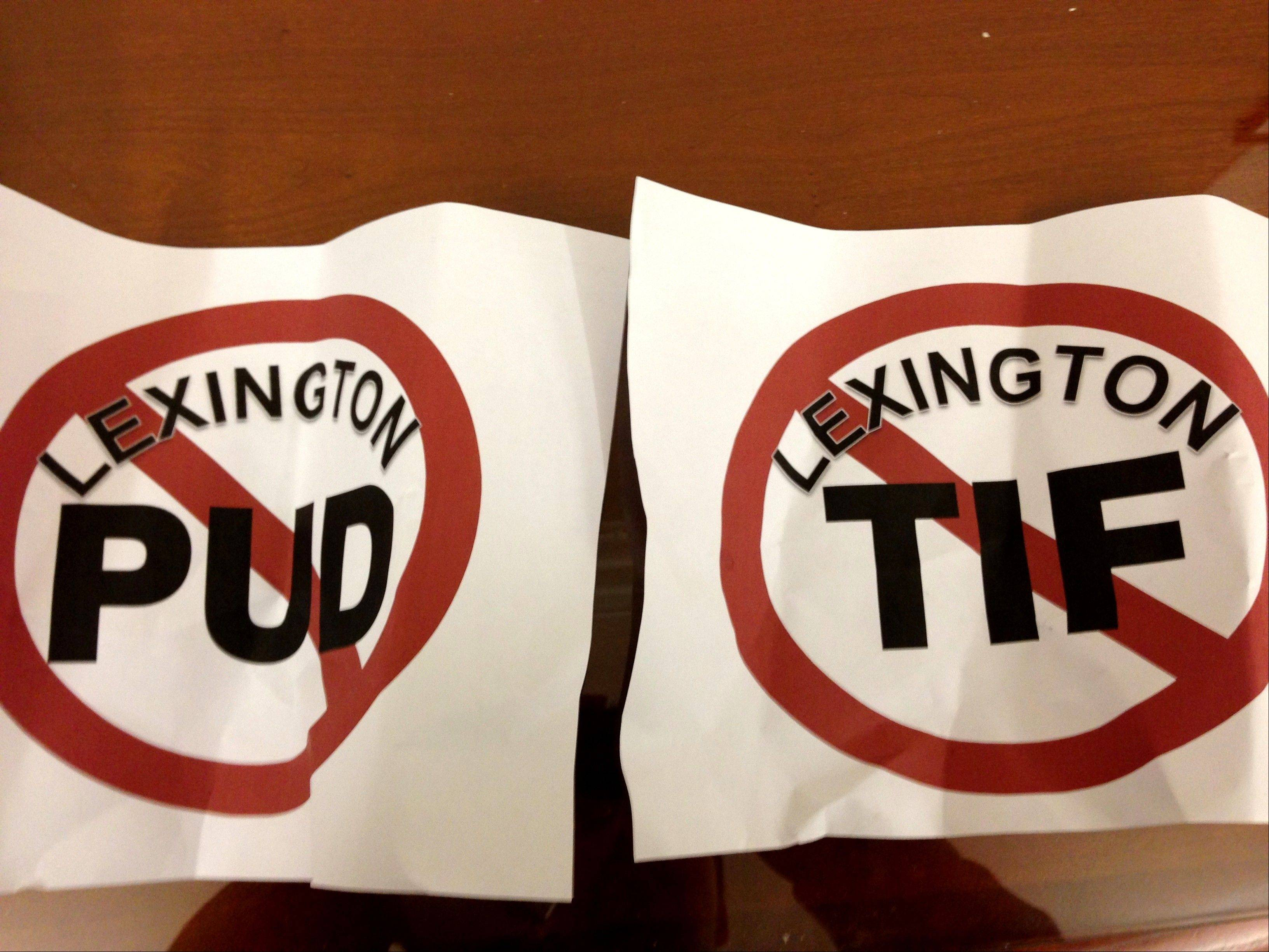 Crumpled versions of handheld signs littered the floor of the St. Charles City Council chamber Monday night as opponents of the Lexington Club development left, stunned by a vote approving the project.