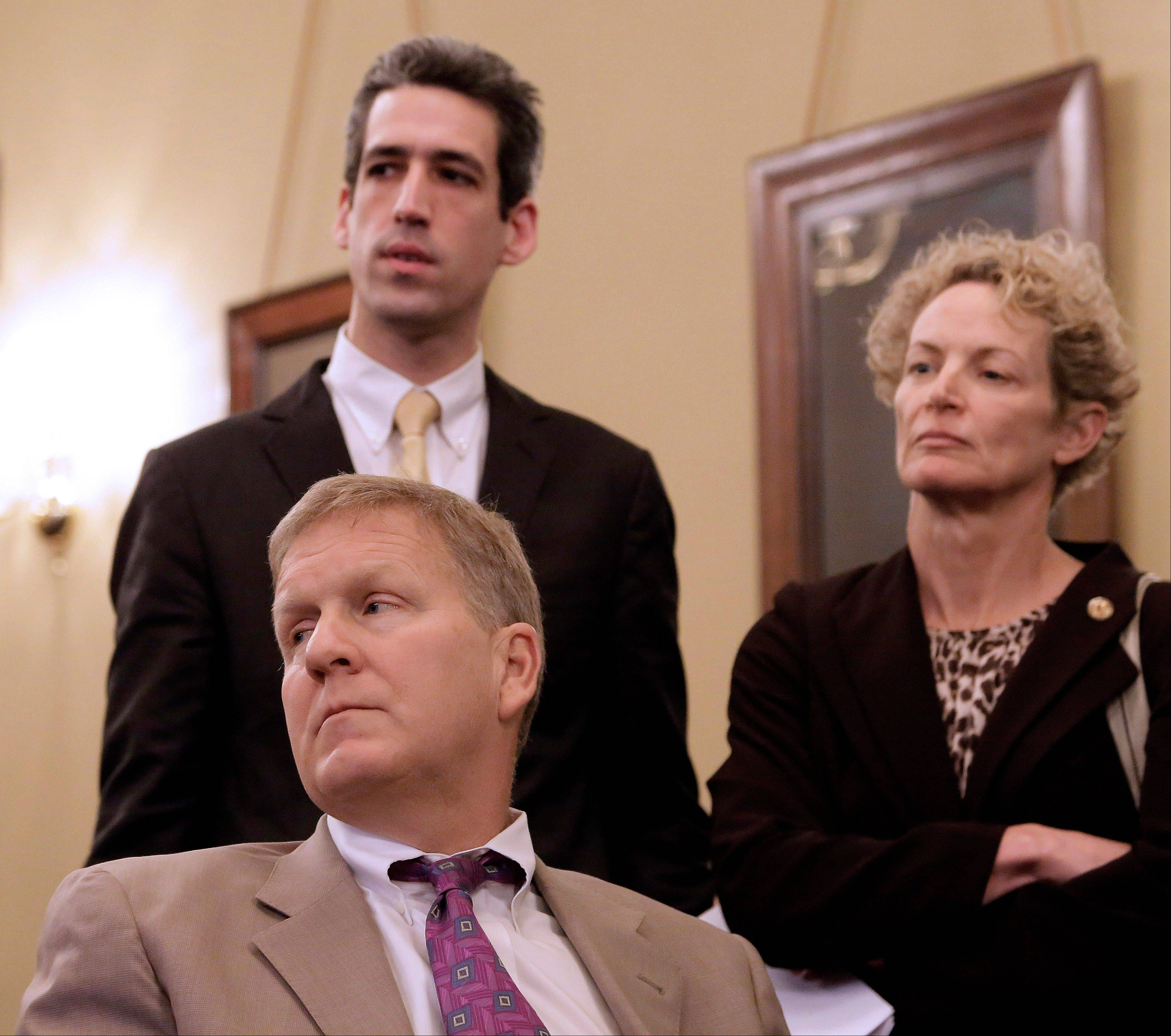 State Rep. Daniel Biss of Evanston, top left, House Republican Leader Tom Cross of Oswego, bottom, and state Rep. Elaine Nekritz of Northbrook, listen to testimony during a House committee hearing at the Capitol Monday.