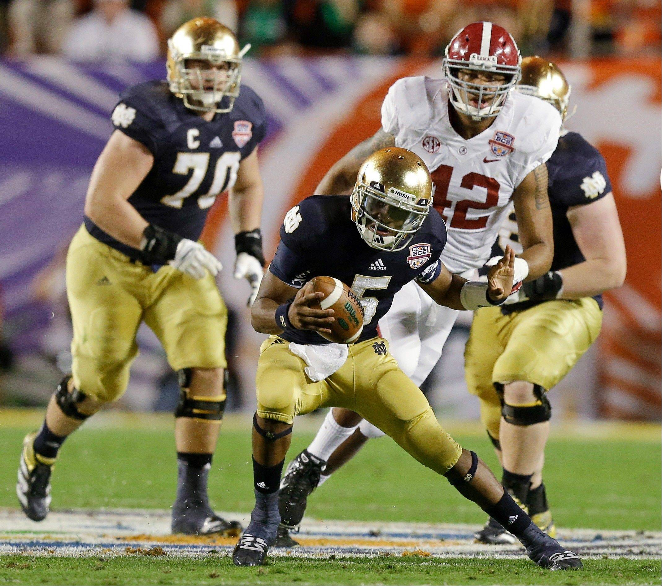 Notre Dame quarterback Everett Golson scrambles during the first half of Monday night�s 42-14 loss to Alabama.