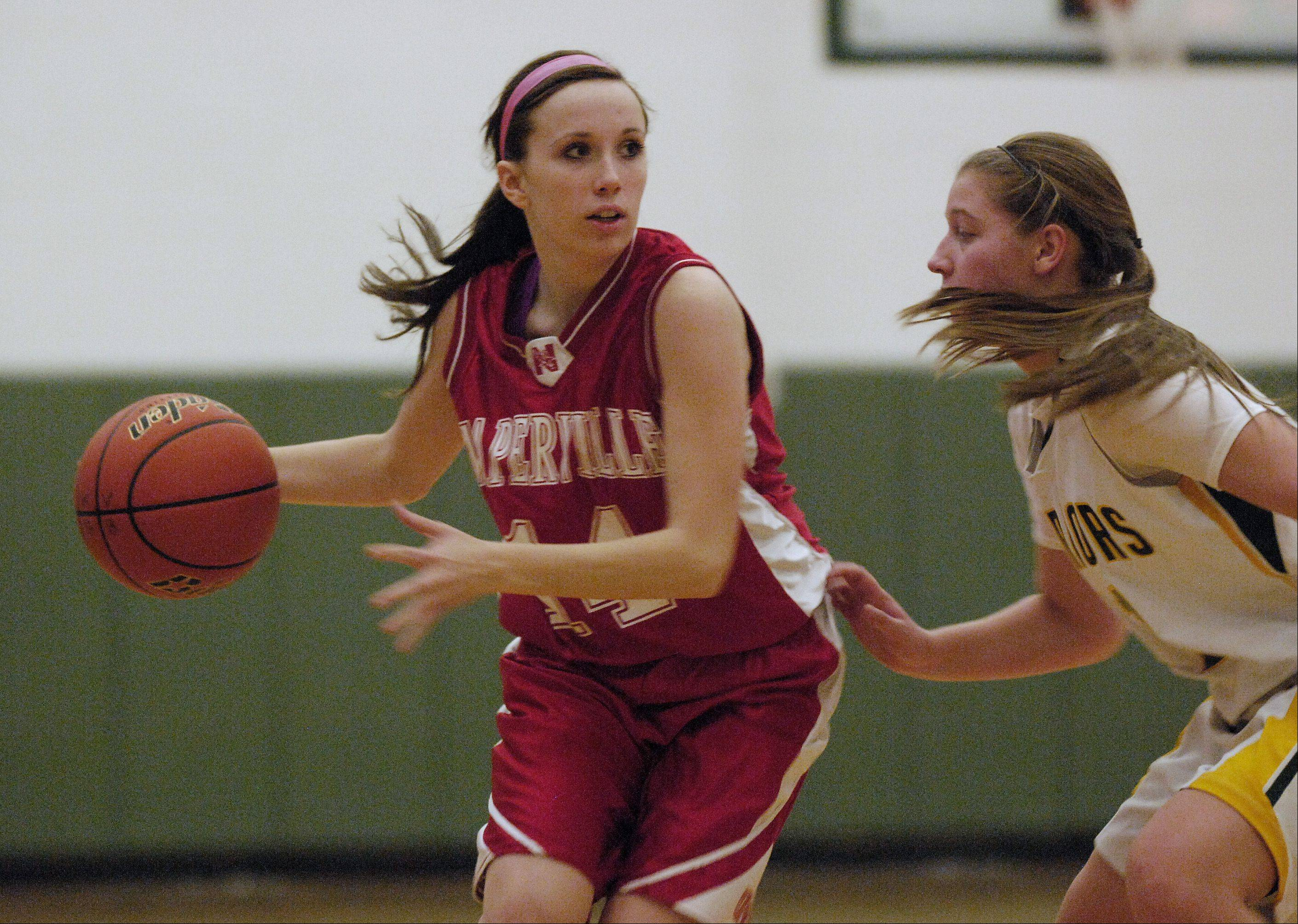 Emily Kraft of Naperville Central looks to get past Kendall O�Sullivan of Waubonsie Valley.