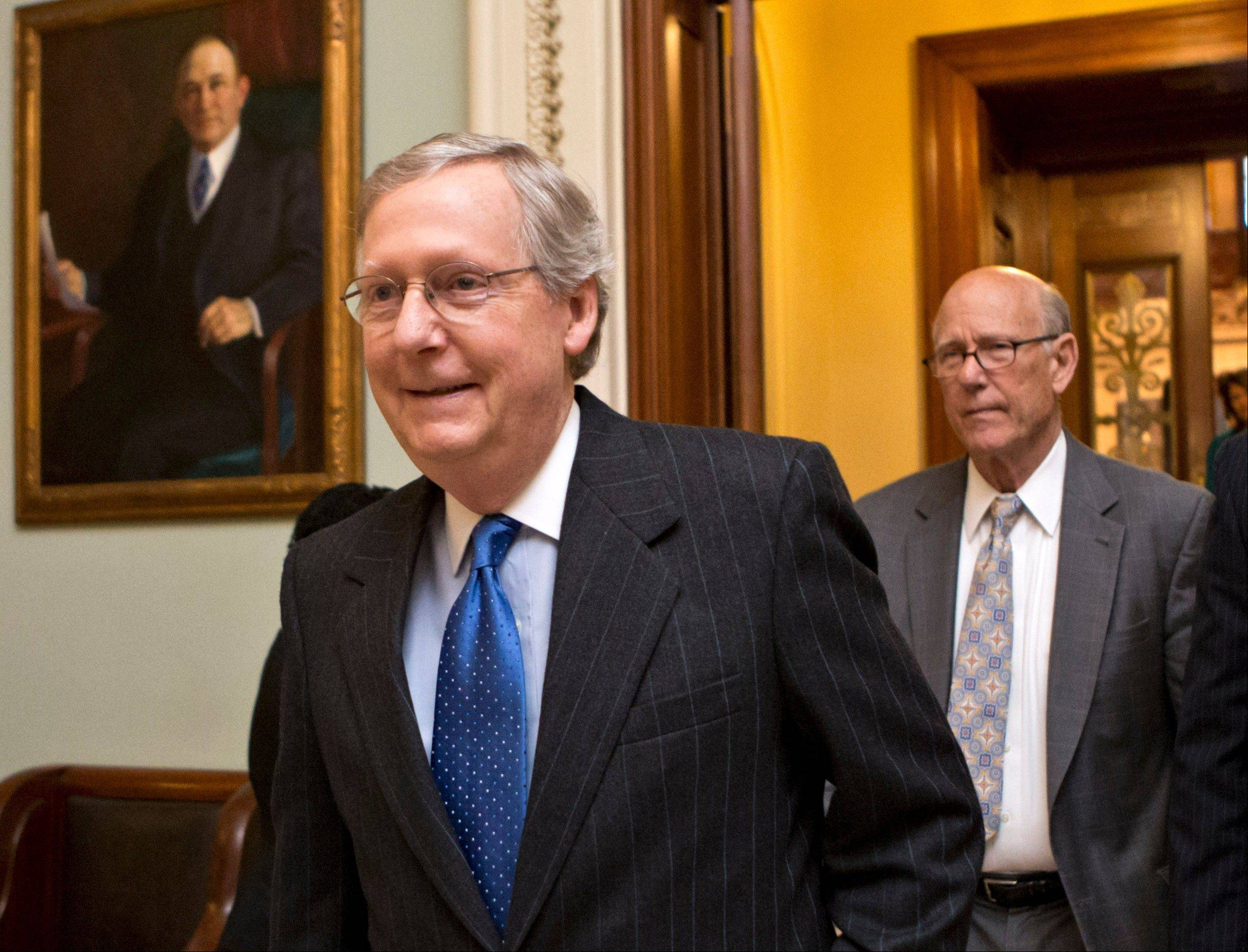 "Senate Republican Leader Mitch McConnell of Kentucky, followed by Sen. Pat Roberts, a Kansas Republican, leave the Senate chamber on Capitol Hill in Washington. President Barack Obama says he won't let Republicans threaten a debt ceiling crisis to extract deeper federal spending cuts, but congressional Republicans say he has no choice. The tough talk suggests this year's political fight could be even nastier and more nerve-grating than the ""fiscal cliff"" showdown."