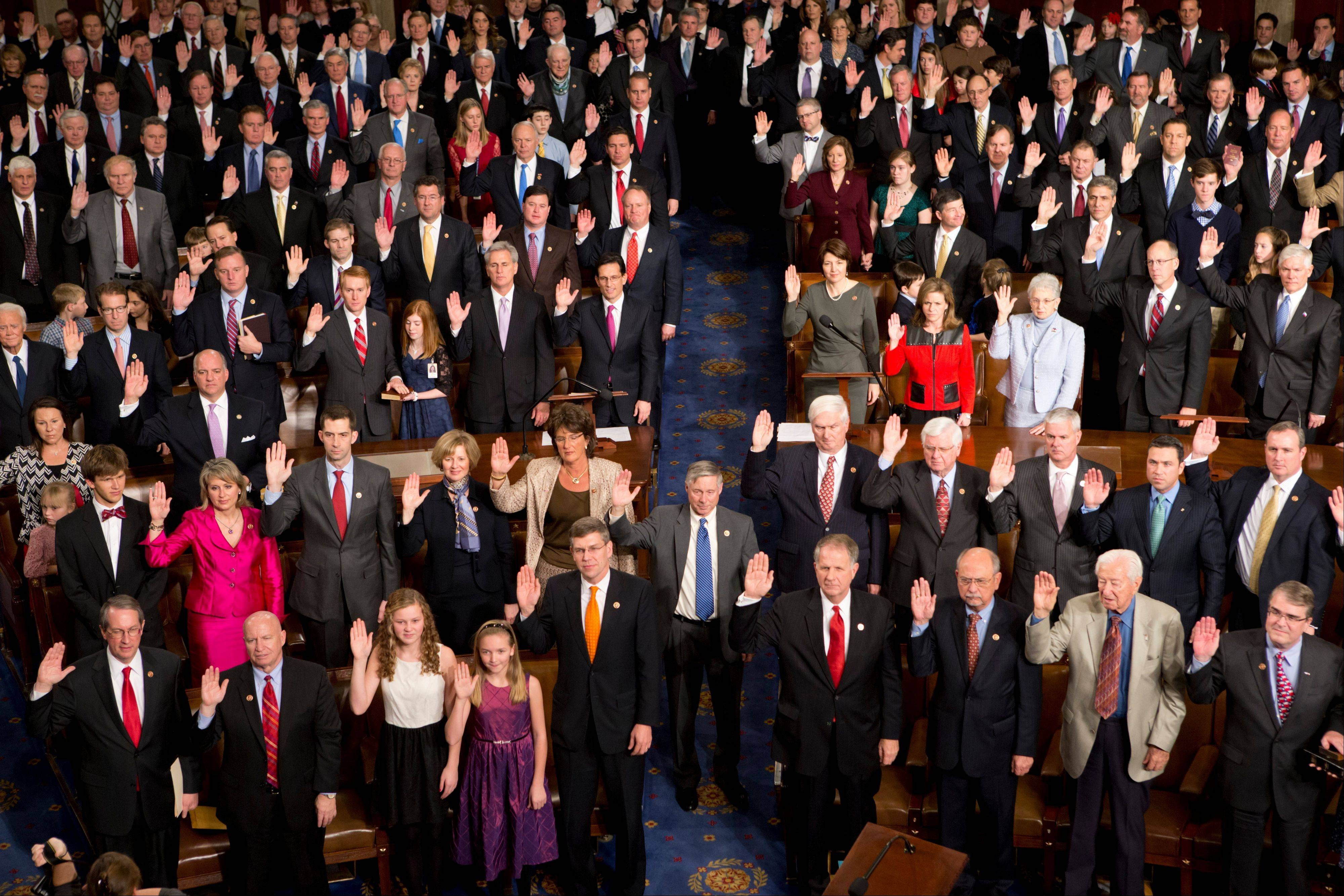 Members of the 113th Congress, many accompanied by family members, take the oath of office Thursday in the House of Representatives chamber on Capitol Hill in Washington.