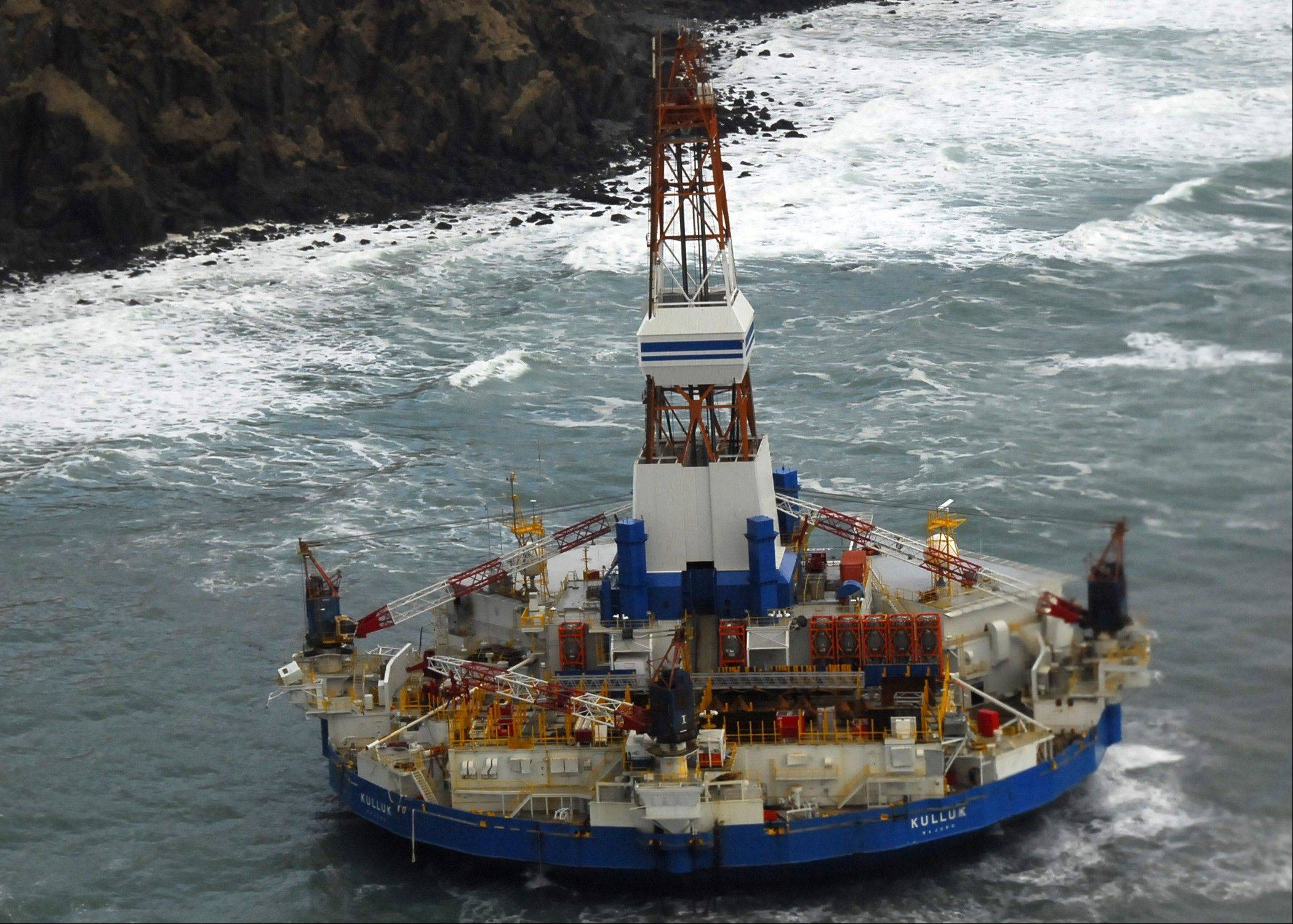 In this image provided Thursday by the U.S. Coast Guard the conical drilling unit Kulluk sits grounded 40 miles southwest of Kodiak City.