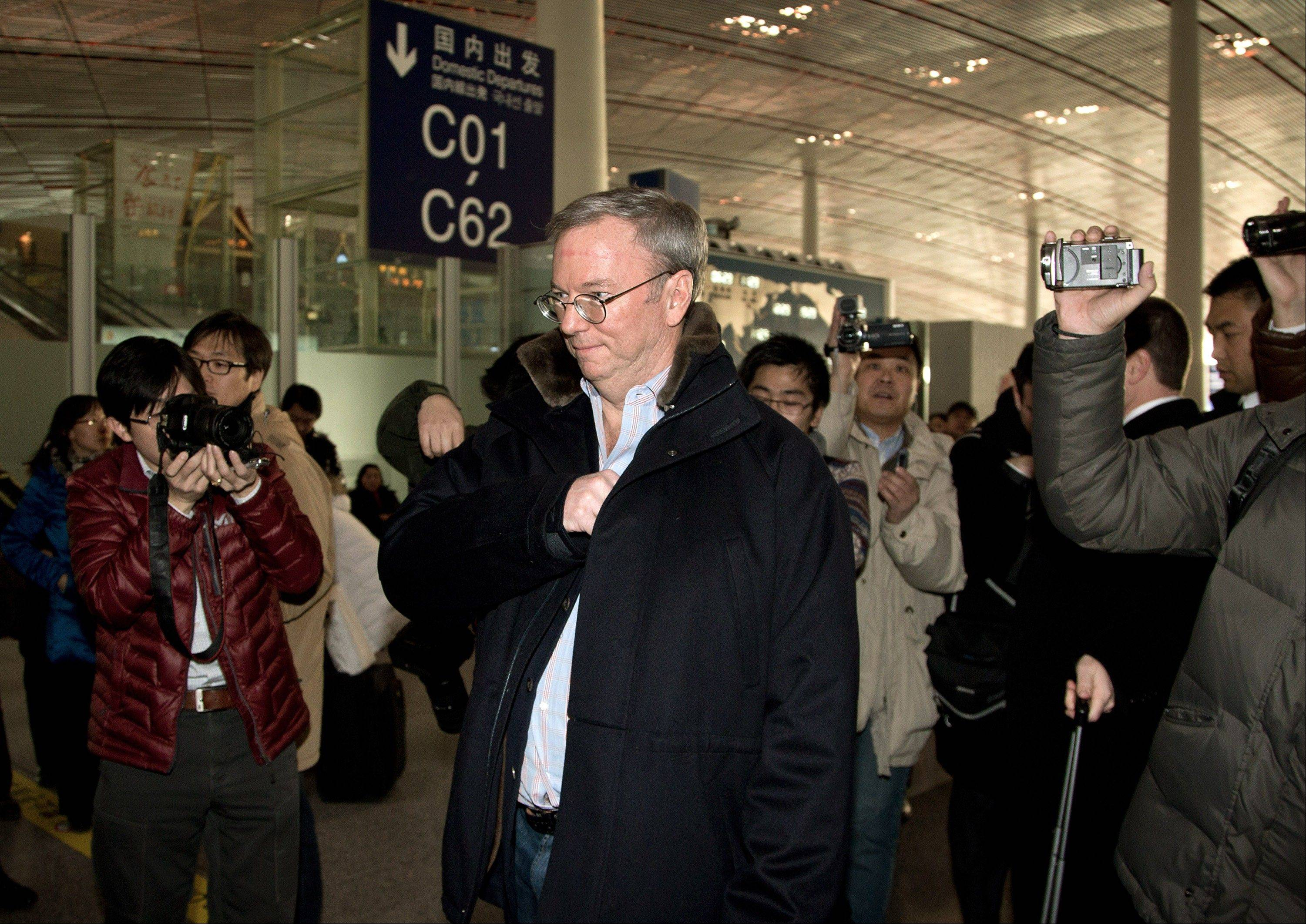 Google's executive chairman Eric Schmidt, center, is chased by journalists Monday as he prepares to check in at the Beijing Capital International Airport in Beijing. Schmidt is scheduled to leave Monday on a commercial flight bound for North Korea, a country considered to have the world's most restrictive Internet policies.