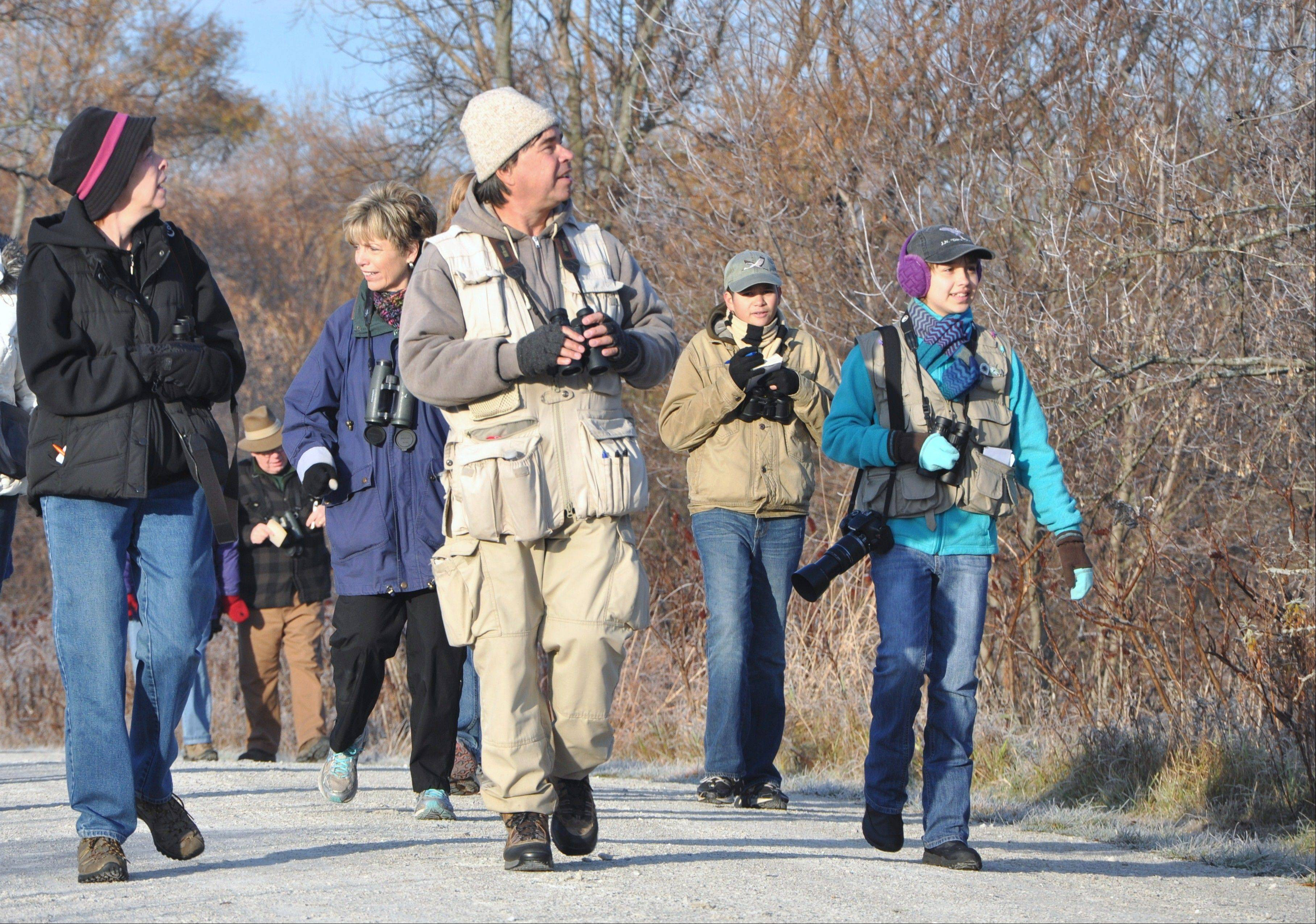 Leader of the patch: Fillmore Dryden, center, enjoys introducing others to the birds of McKee Marsh in Warrenville.