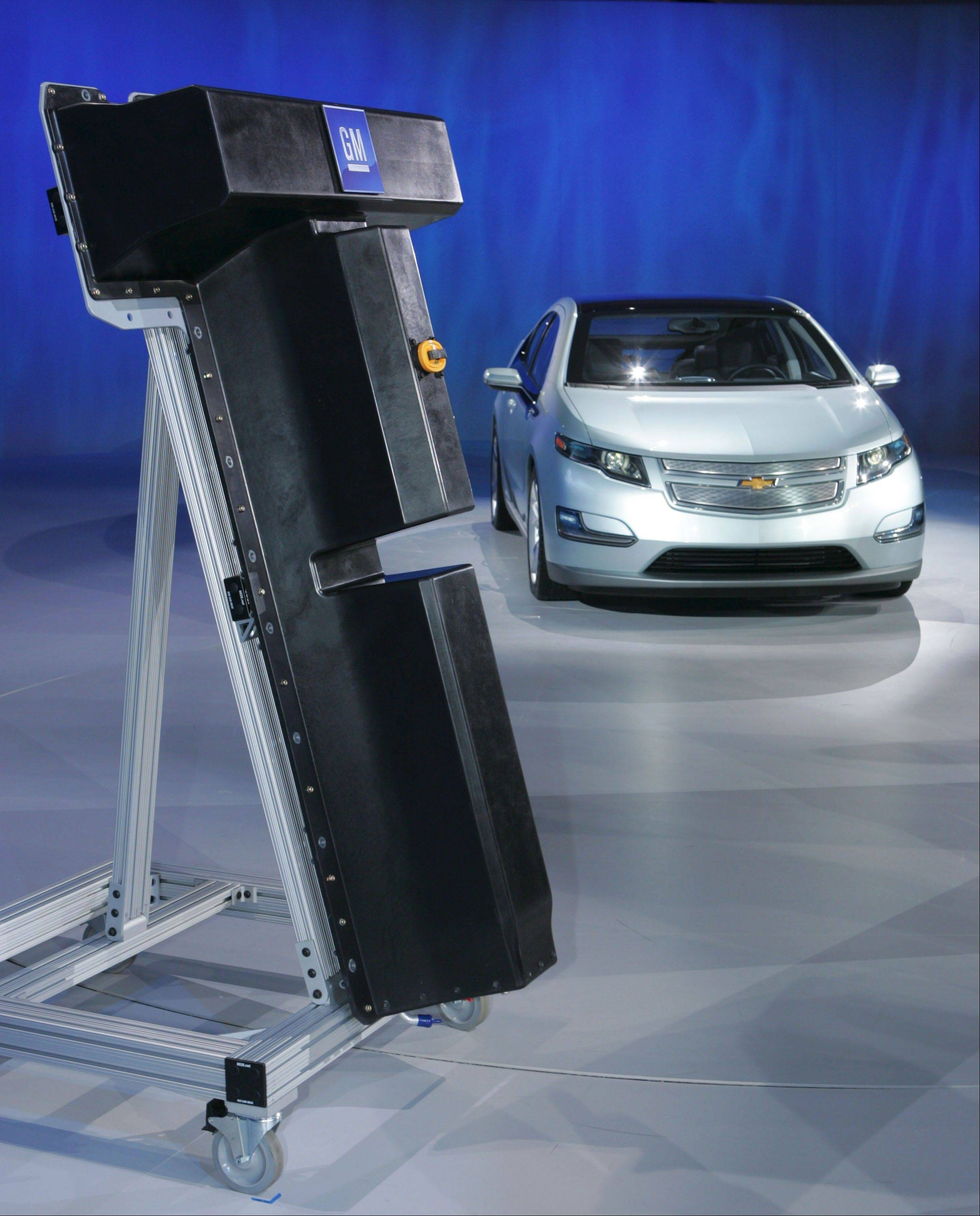 The heft of the Chevrolet Volt battery is apparent from this replica on display next to a Volt at a 2009 General Motors event.