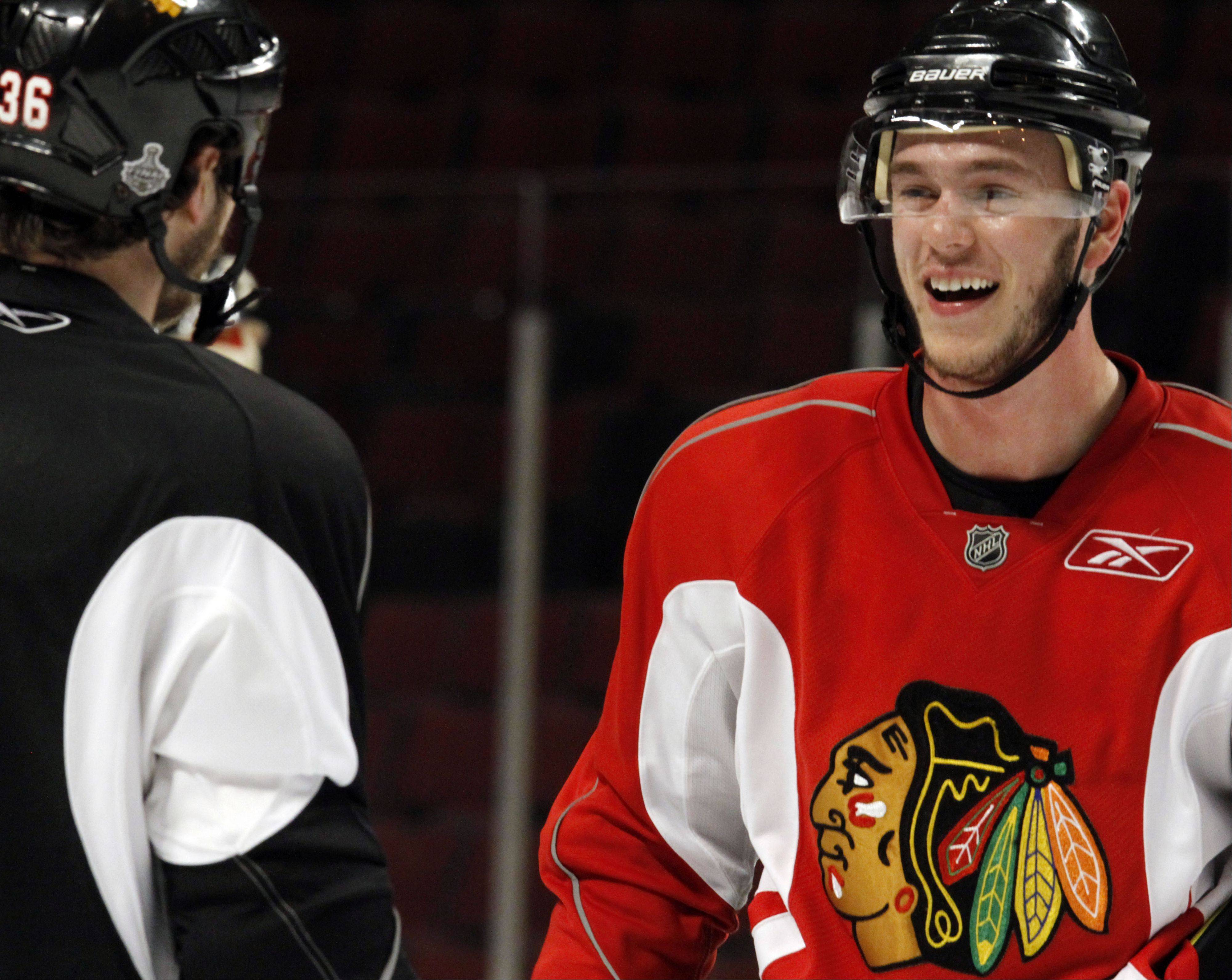 "Chicago Blackhawks' Jonathan Toews, right, seen here in 2010 says he's ready to get back on the ice on the heels of a tentative deal between players and owners. ""As players we need to keep showing out fans we care. We might have a long road ahead of us there, but for now it's great to know we'll be back on the ice very soon,"" Toews said via text on Sunday."