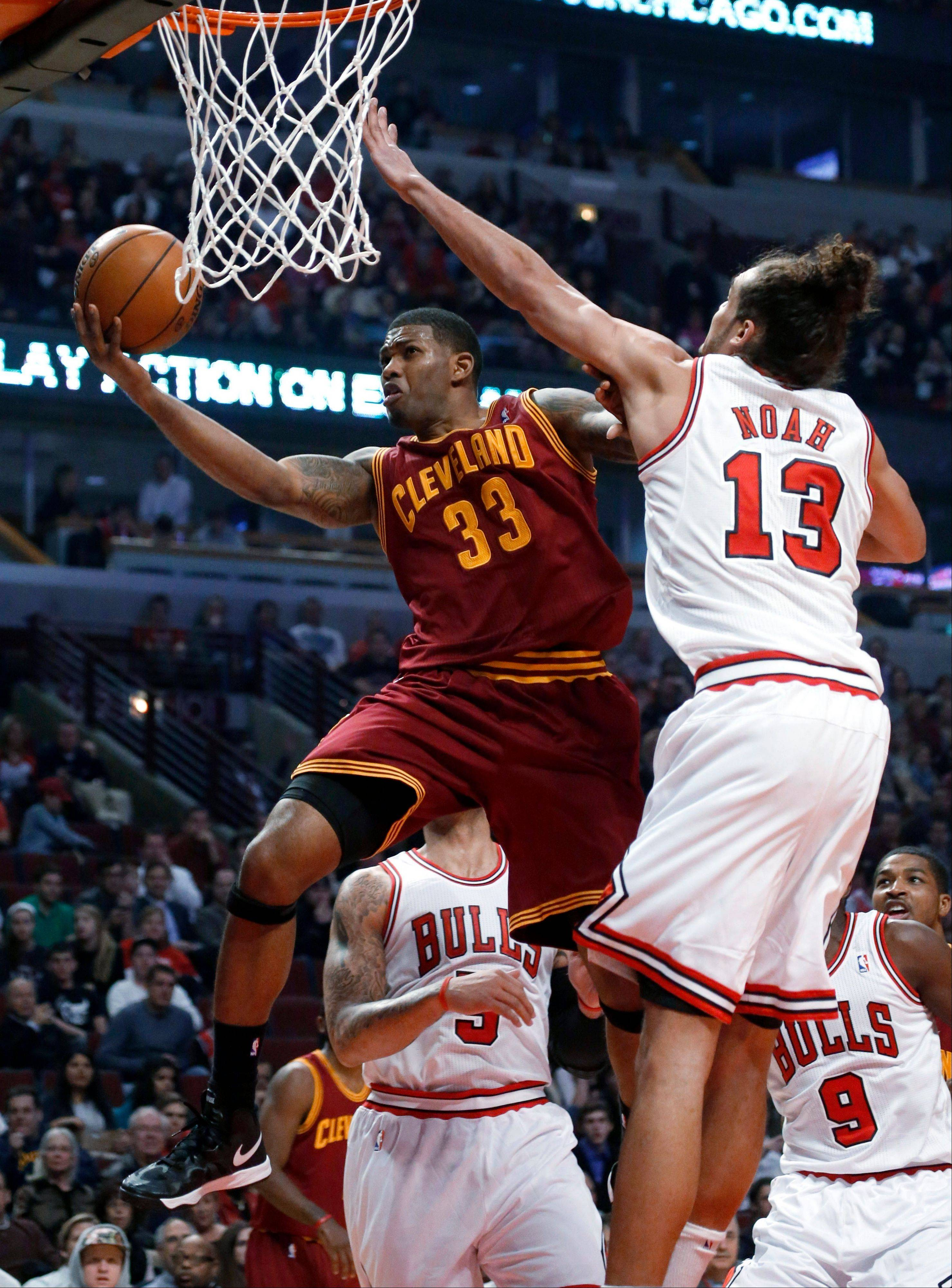Cavaliers forward Alonzo Gee drives under pressure from Bulls center Joakim Noah during the first half Monday at the United Center.