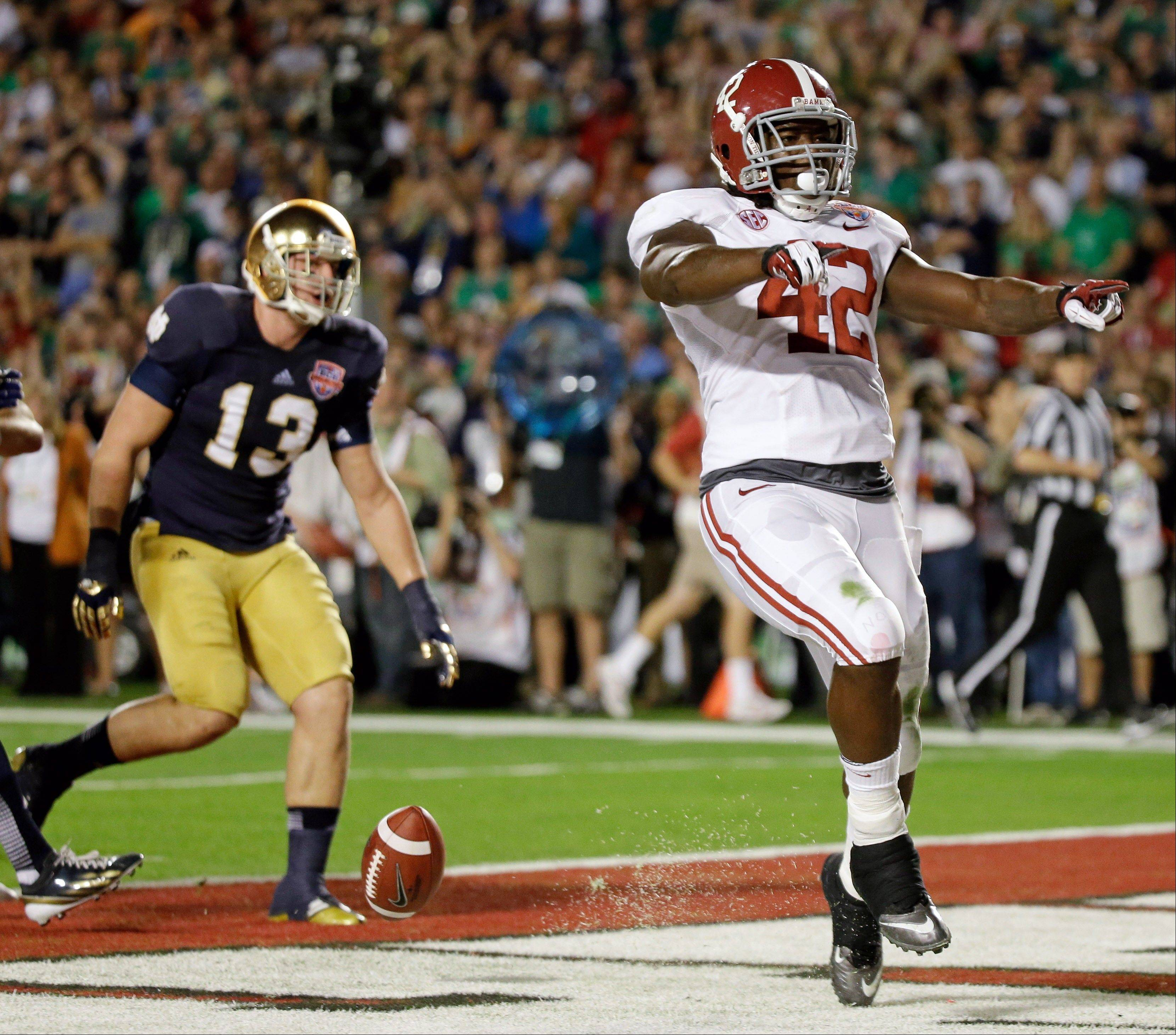 Alabama's Eddie Lacy reacts after rushing for a touchdown during the first half of the BCS championship football game against Notre Dame Monday, Jan. 7, 2013, in Miami.