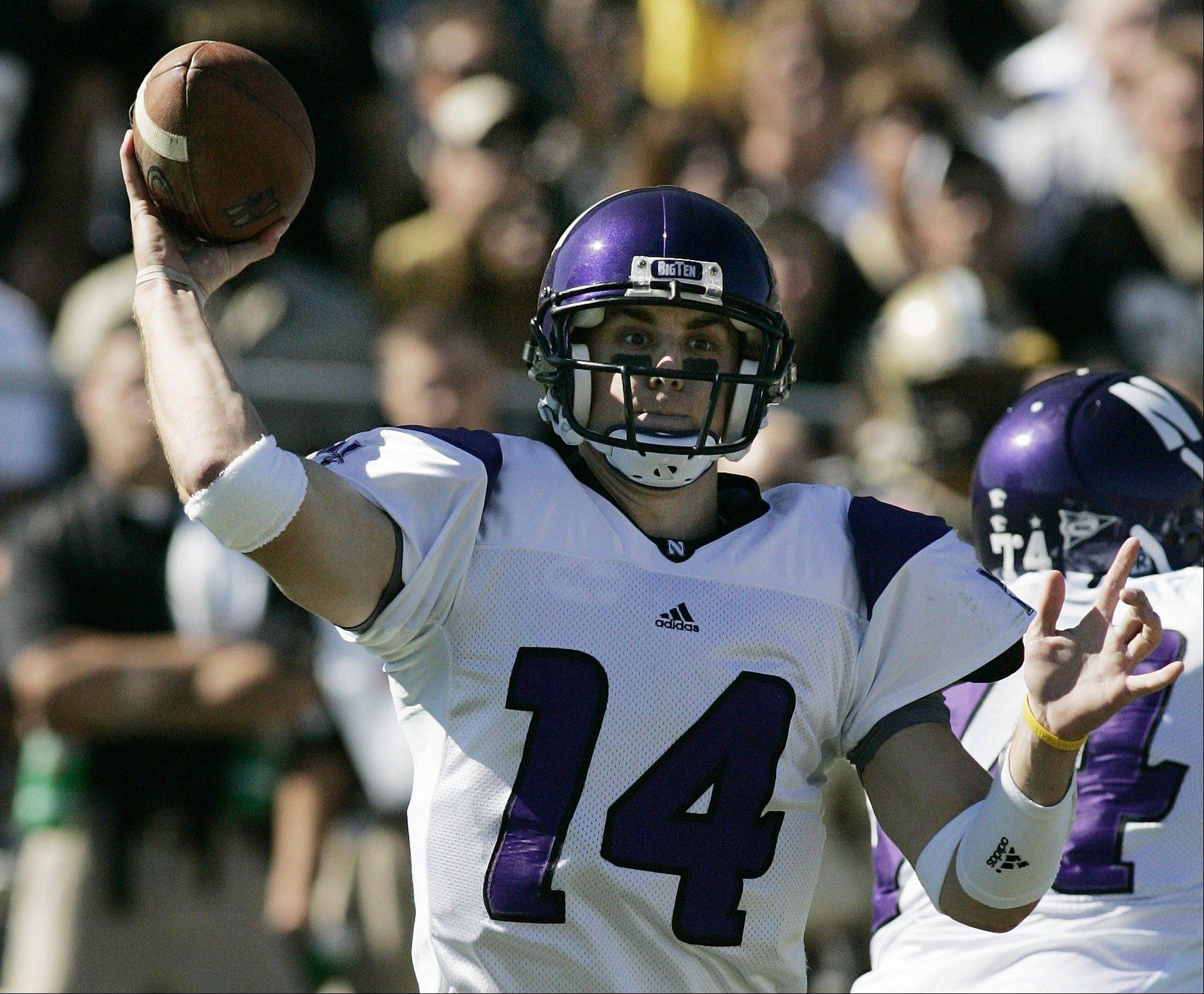 Quarterback Brett Basanez, here throwing a pass during his Northwestern days, is among the recent inductees to St. Viator's Athletics Hall of Fame.