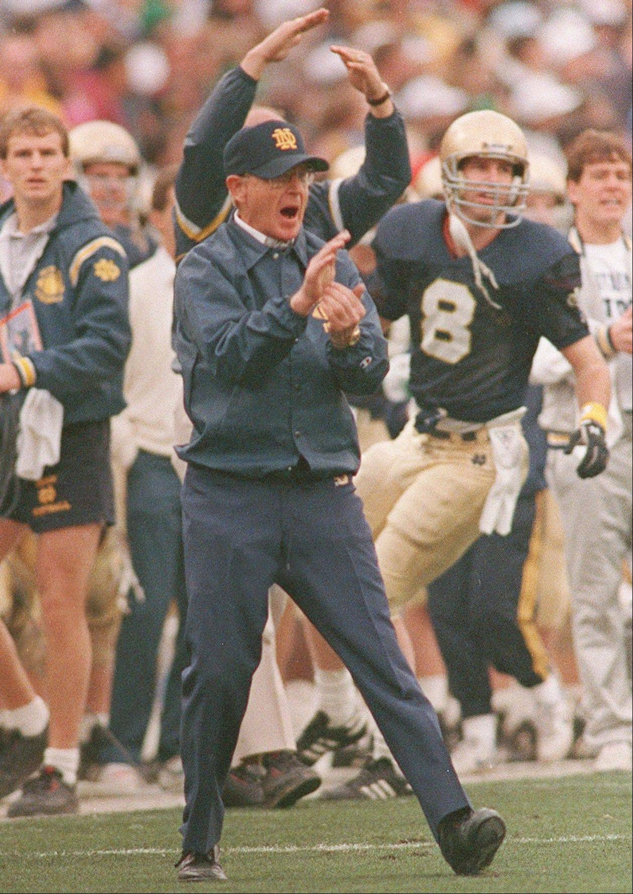 Notre Dame coach Lou Holtz yells encouragement to the Irish against West Virginia in the Fiesta Bowl in Tempe, Ariz.