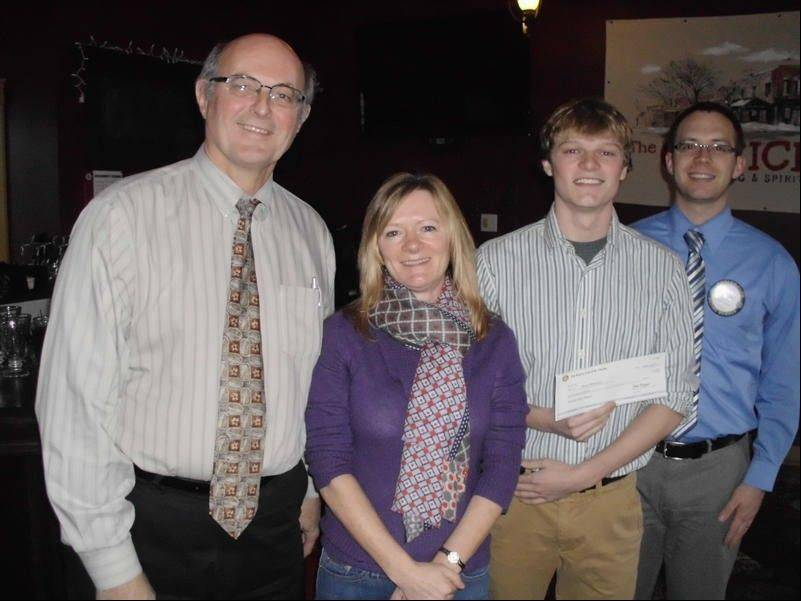 John Kunzer, left, St. Charles Rotary Club Foundation treasurer, and Scott Piner, club president, award St. Charles North graduate Bruce Wittmann, and his mother, Kate, with a $2,500 Scholarship.
