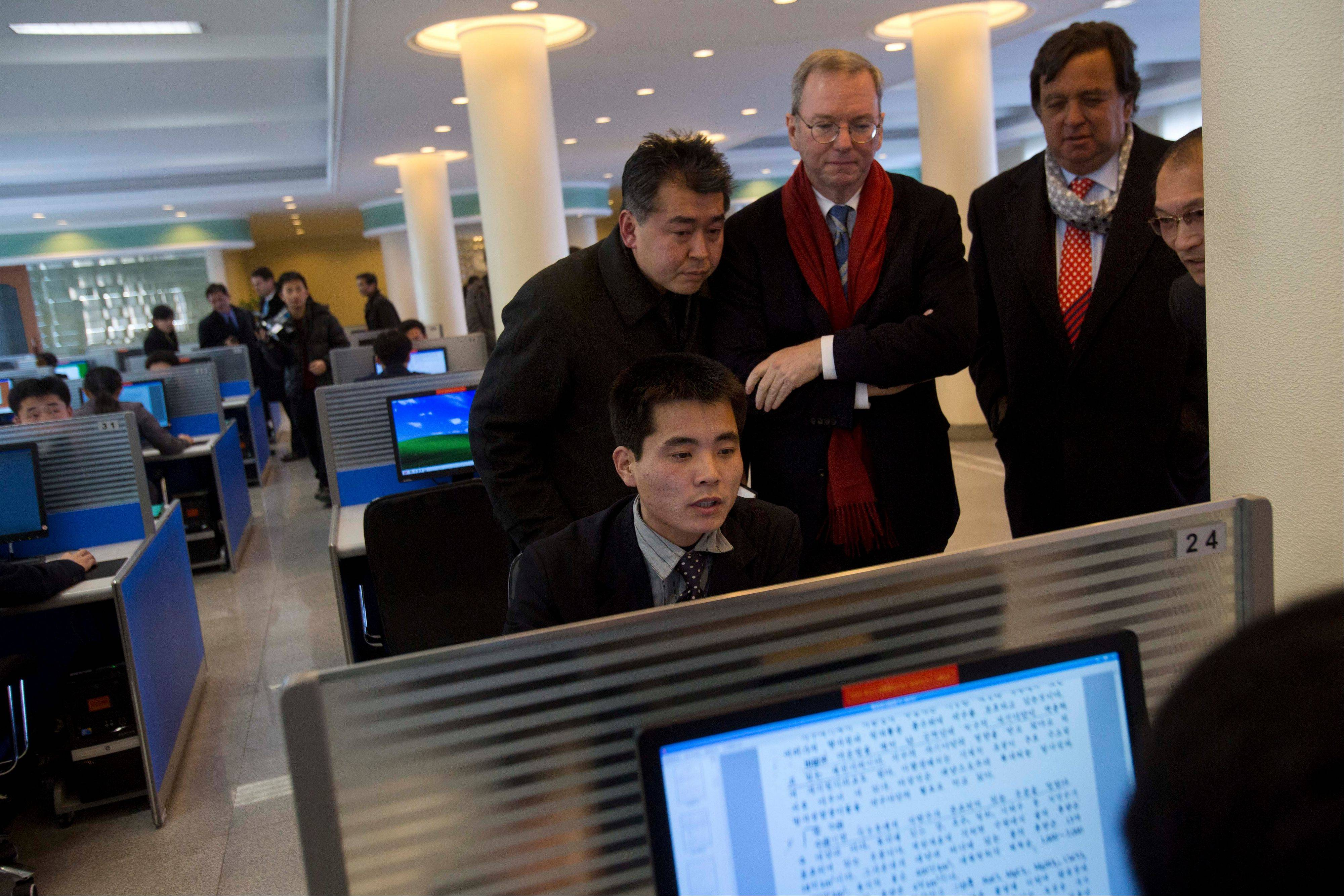 Executive Chairman of Google, Eric Schmidt, third from left, and former New Mexico governor Bill Richardson, second from right, watch Tuesday as a North Korean student surfs the Internet at a computer lab during a tour of Kim Il Sung University in Pyongyang, North Korea. Schmidt is the highest-profile U.S. executive to visit North Korea � a country with notoriously restrictive online policies � since young leader Kim Jong Un took power a year ago.