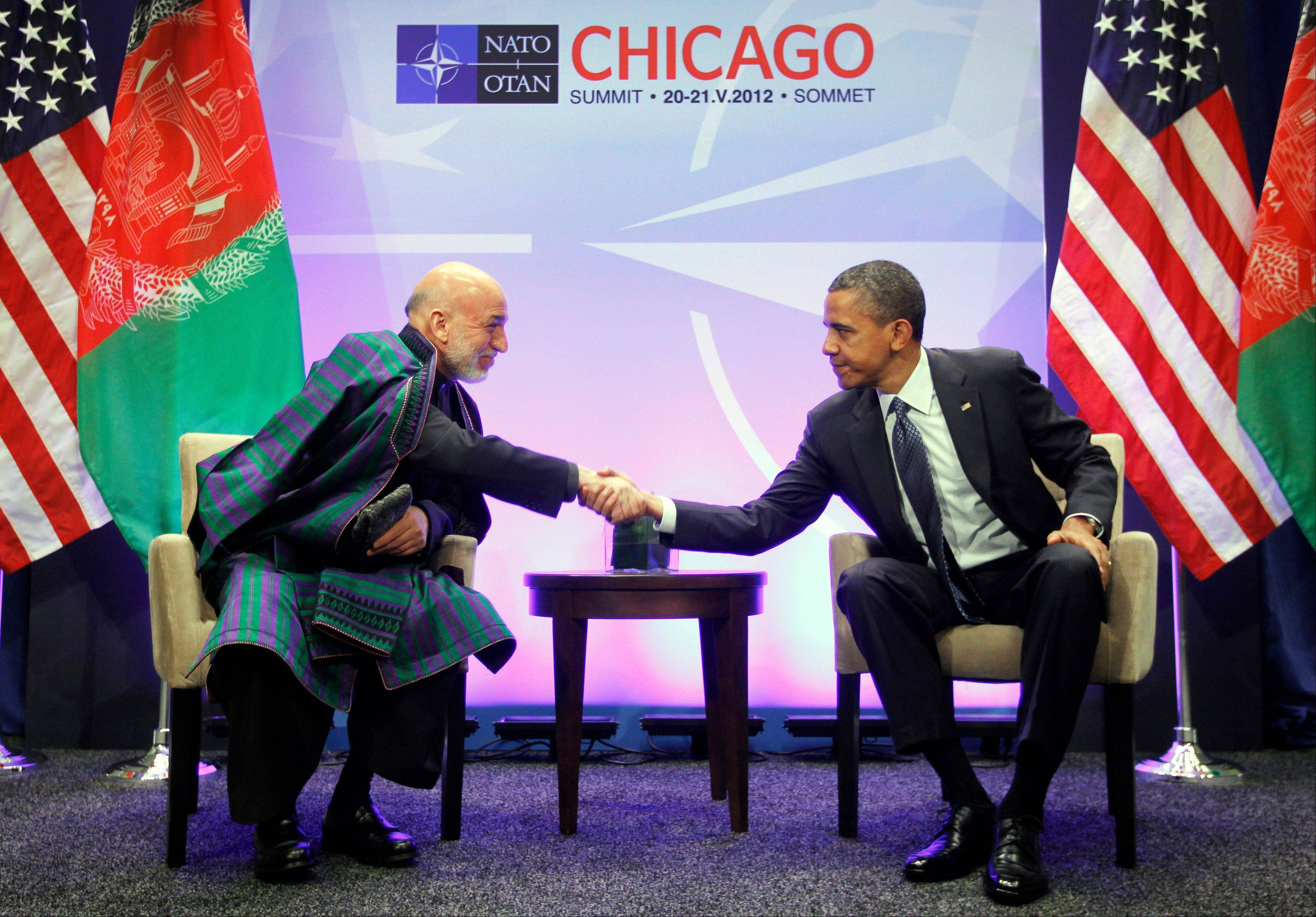 President Barack Obama, right, meets with Afghan President Hamid Karzai, left, during their meeting at the NATO Summit in Chicago last May 20. The Obama administration gave the first explicit signal Tuesday it might leave no troops in Afghanistan after December 2014.