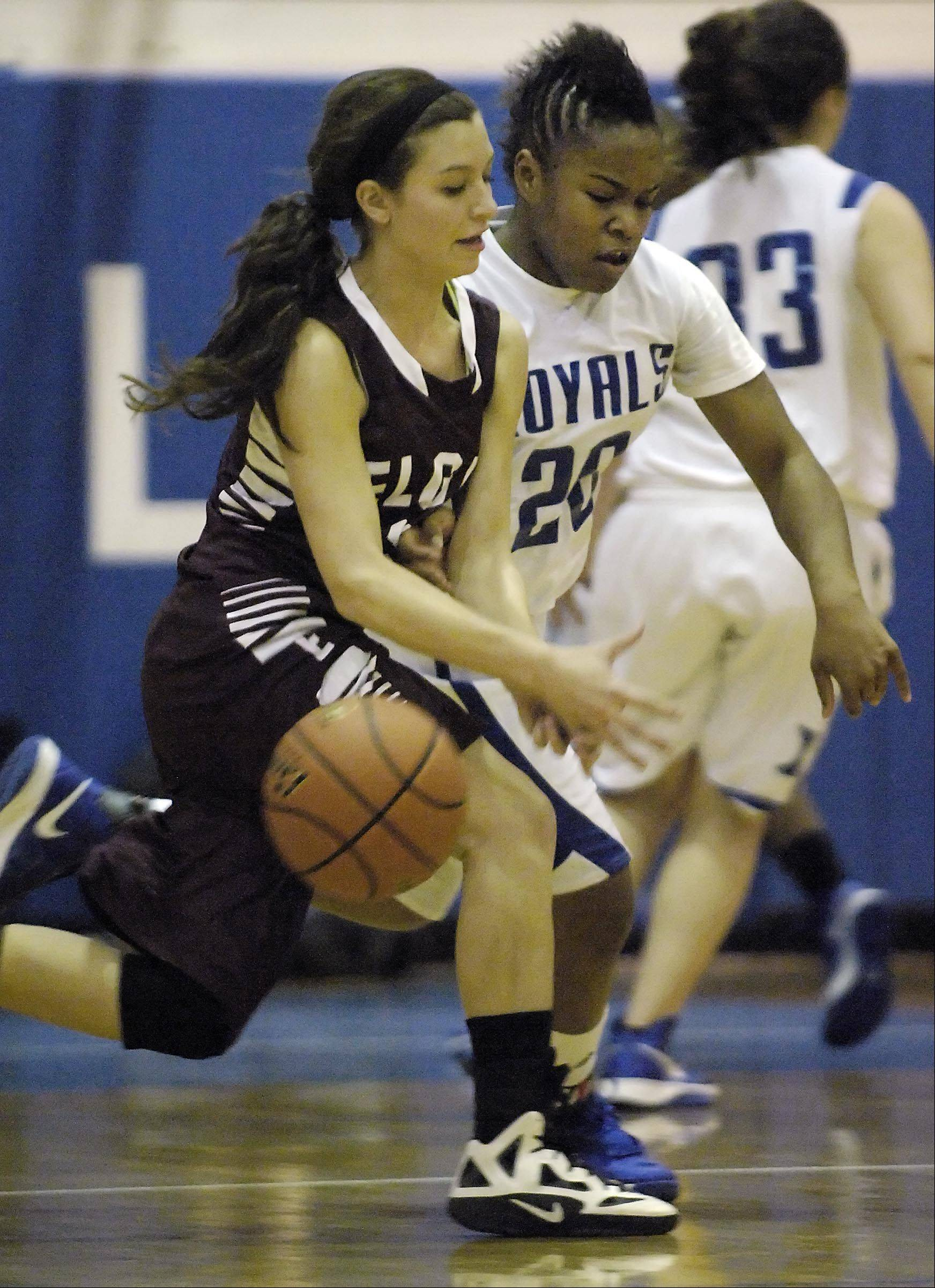 Larkin�s Quixmia Washington (20) punches the ball away from Elgin�s Maggie Powers Tuesday at Larkin High School in Elgin.