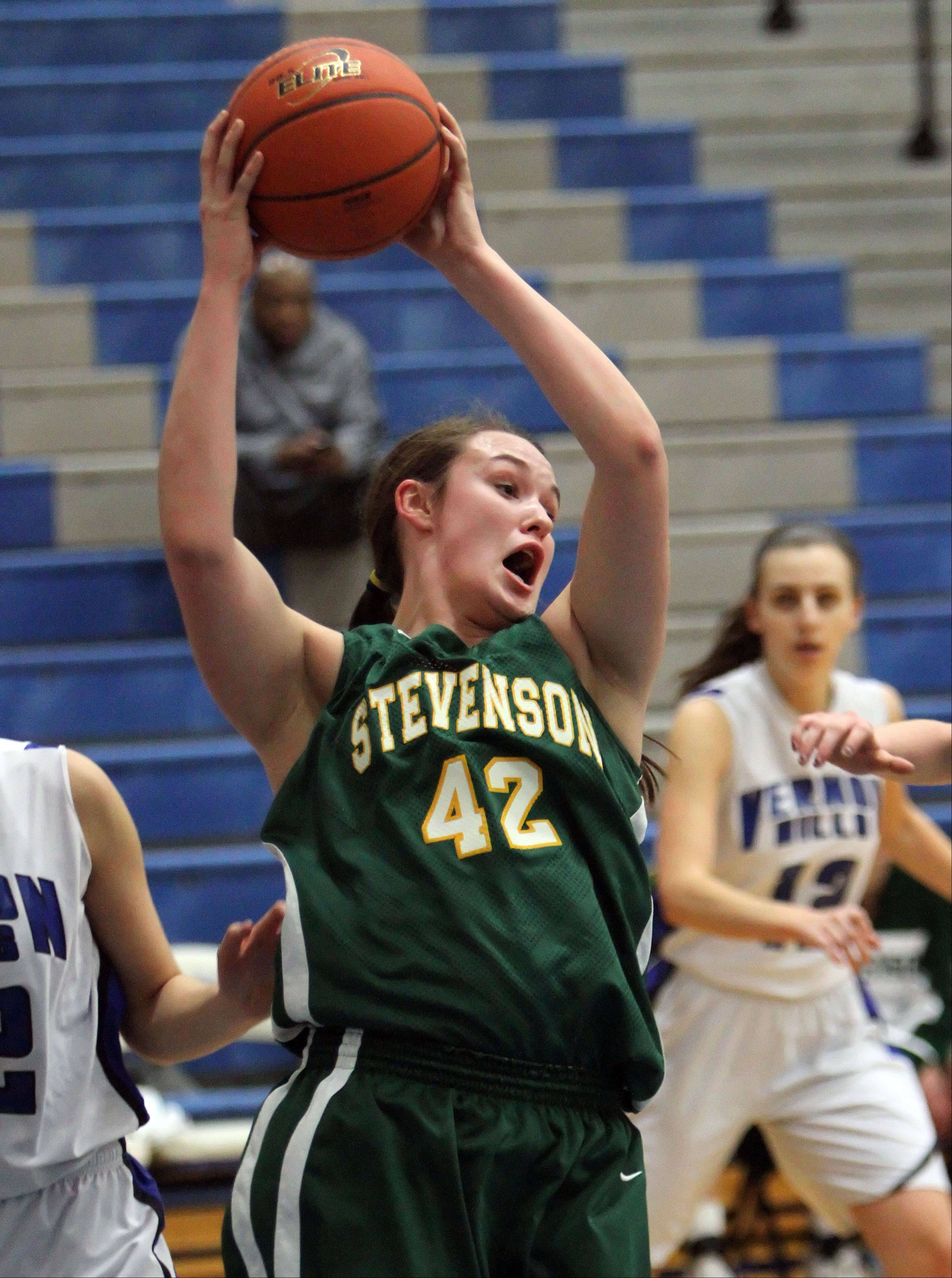 Stevenson's Alex Elzinga pulls down a rebound Tuesday night at Vernon Hills.