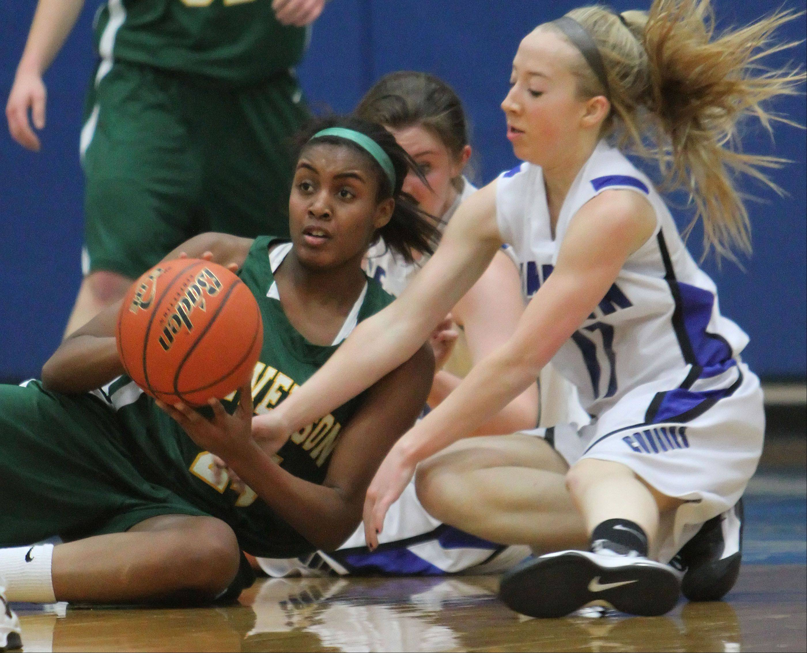 Stevenson�s Taylor Buford, left, and Vernon Hills� Haley Lieberman scramble on the floor for a loose ball.