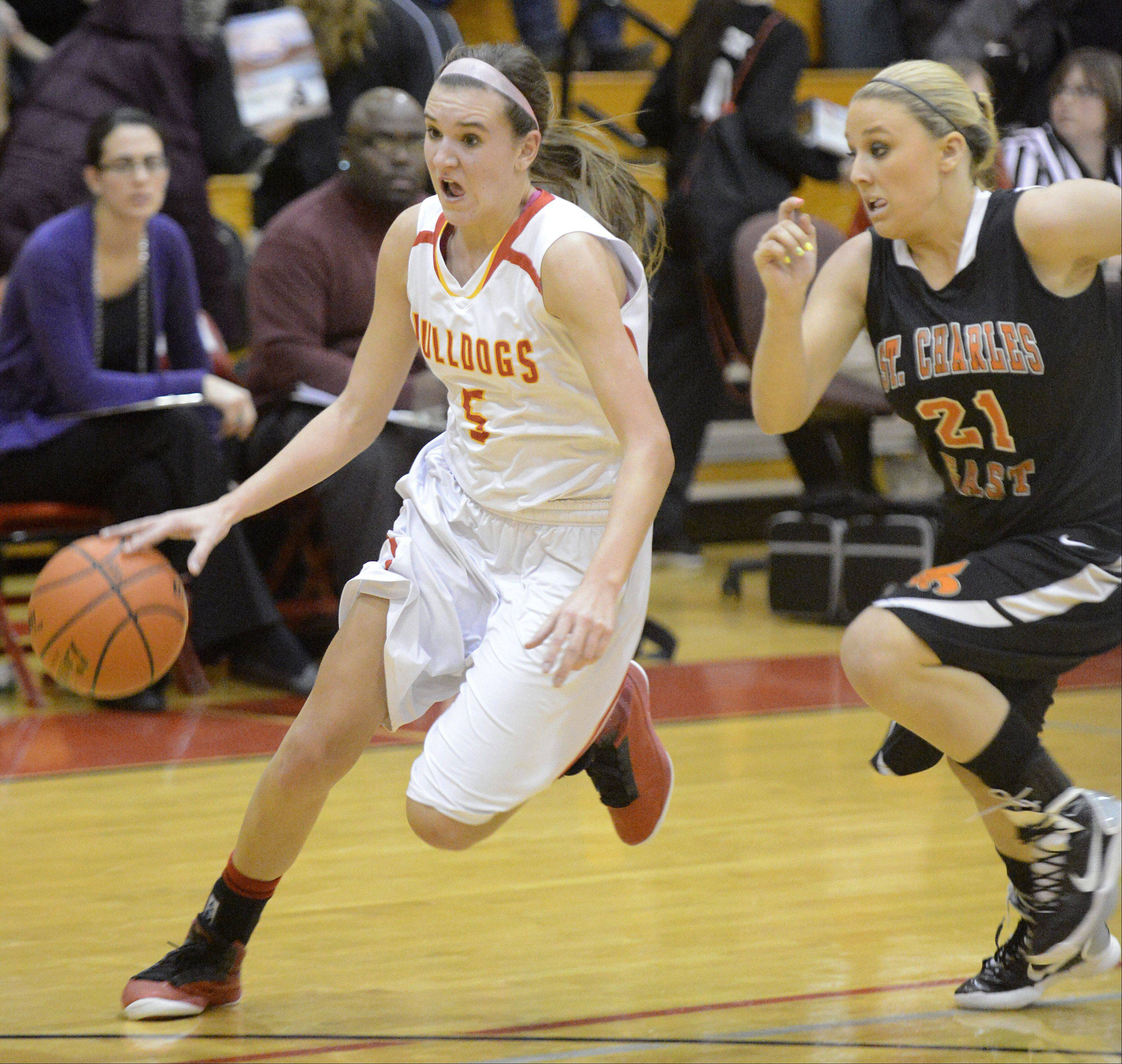 Batavia�s Liza Fruendt speeds past St. Charles East�s MacKenzie Meadows towards the hoop in the second quarter.