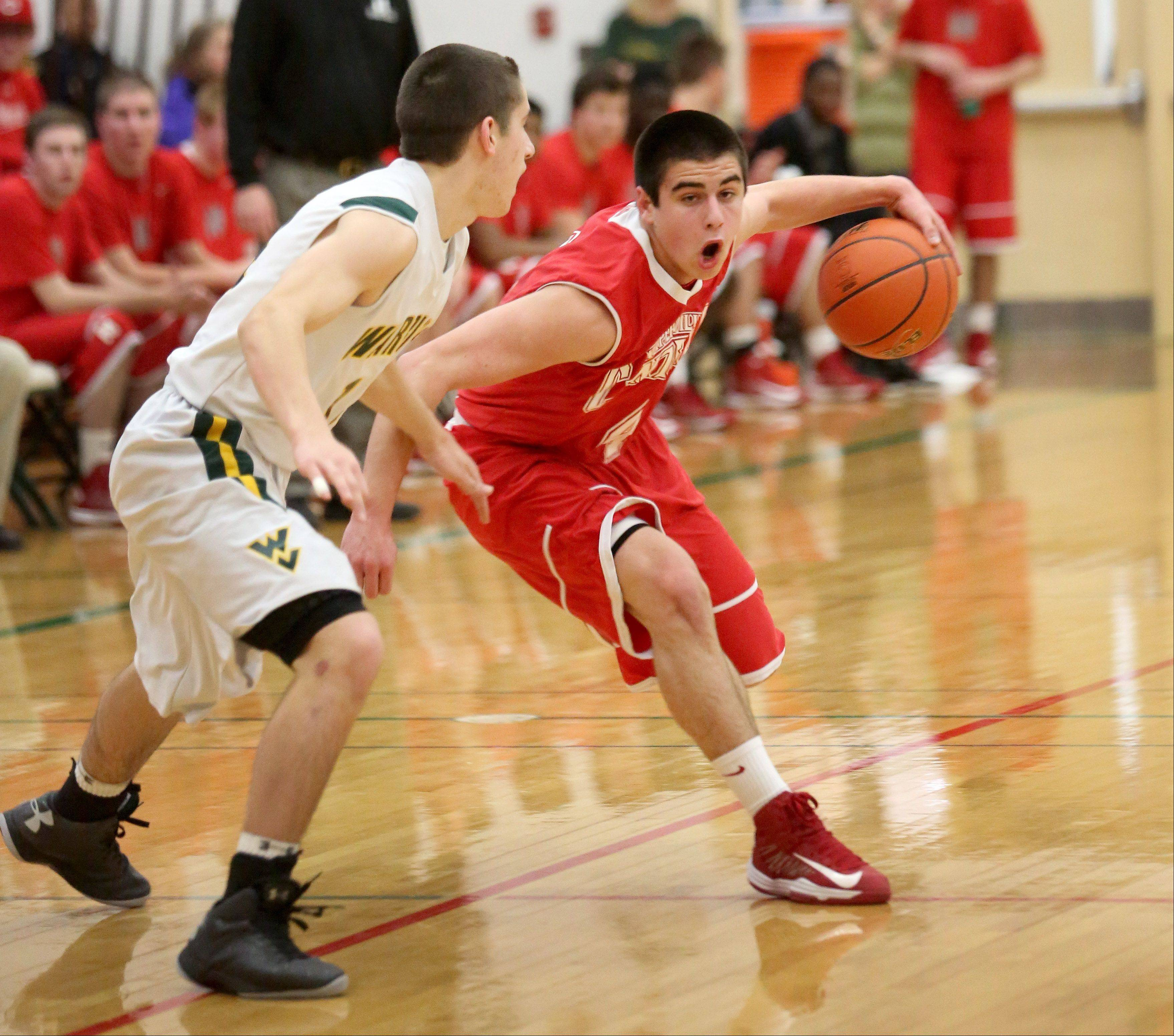 Ryan Antony of Naperville Central, right, moves around Nick Karkazis of Waubonsie Valley.