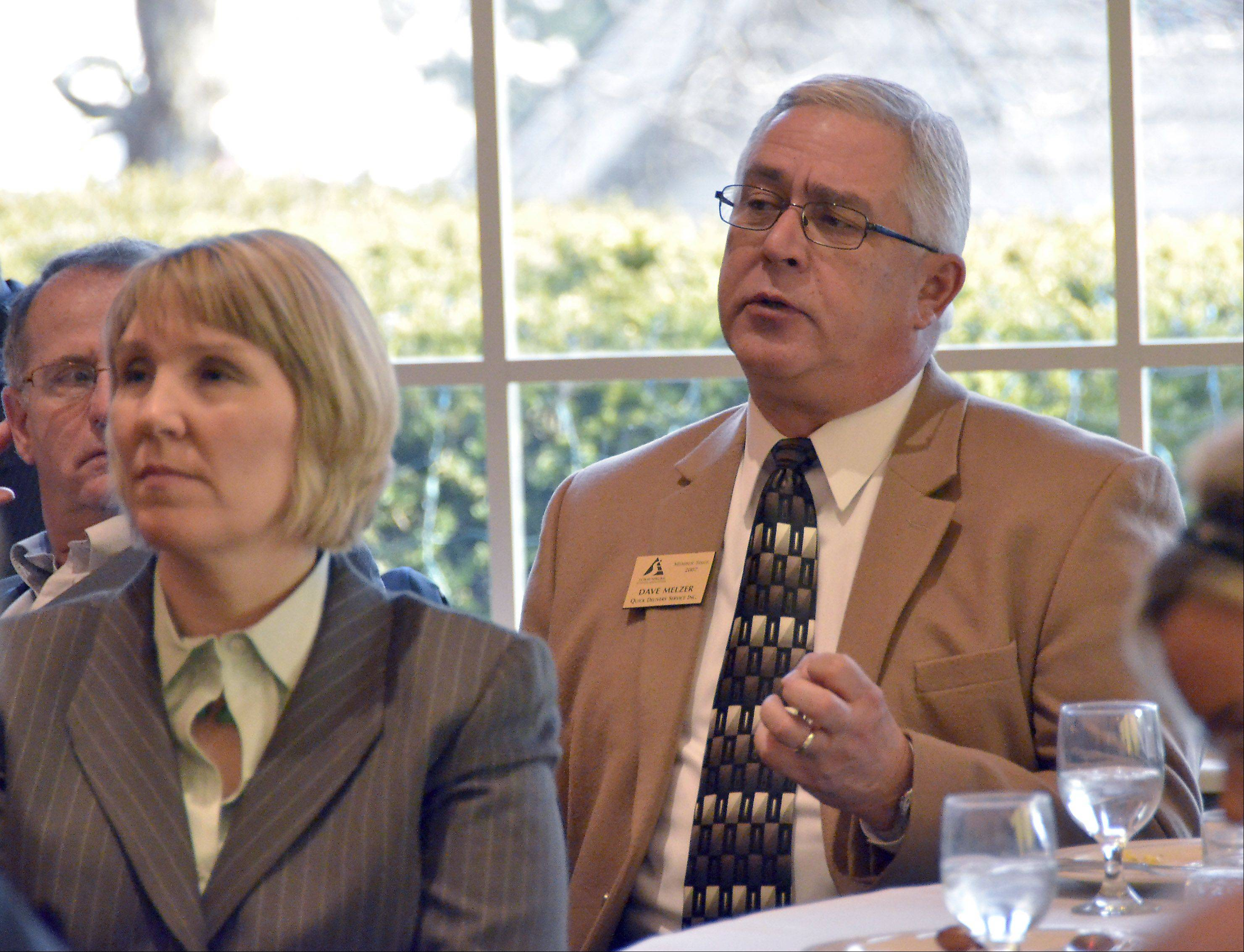 Dave Melzer with Quick Delivery Service asks Schaumburg Mayor Al Larson about emerald ash borer at the Schaumburg Business Association meeting Tuesday at Chandler's in Schaumburg.