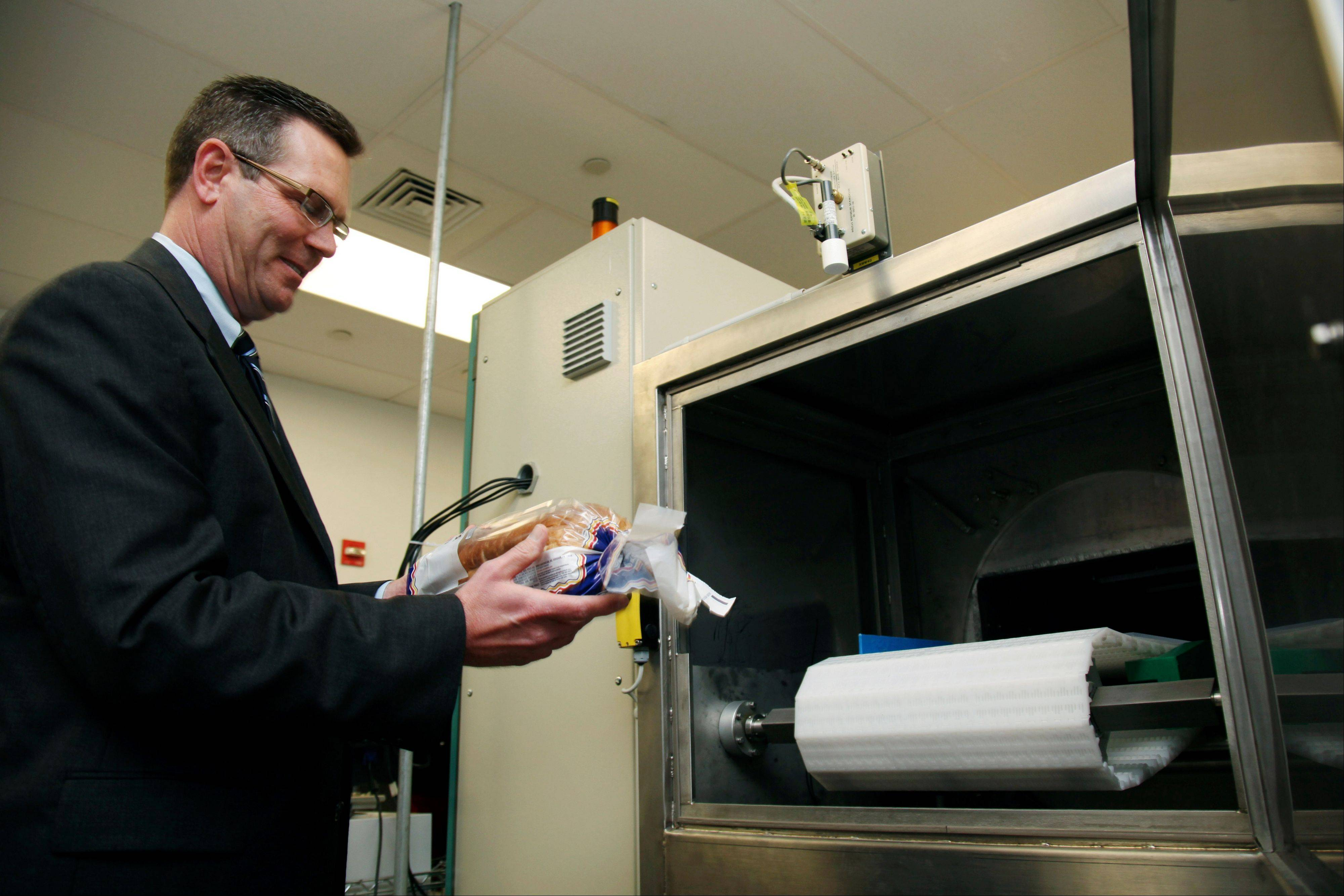 Don Stull, chief executive officer of Microzap, Inc., places a loaf of bread inside a patented microwave that kills mold spores in Lubbock, Texas. The company claims the technology allows bread to stay mold-free for 60 days.